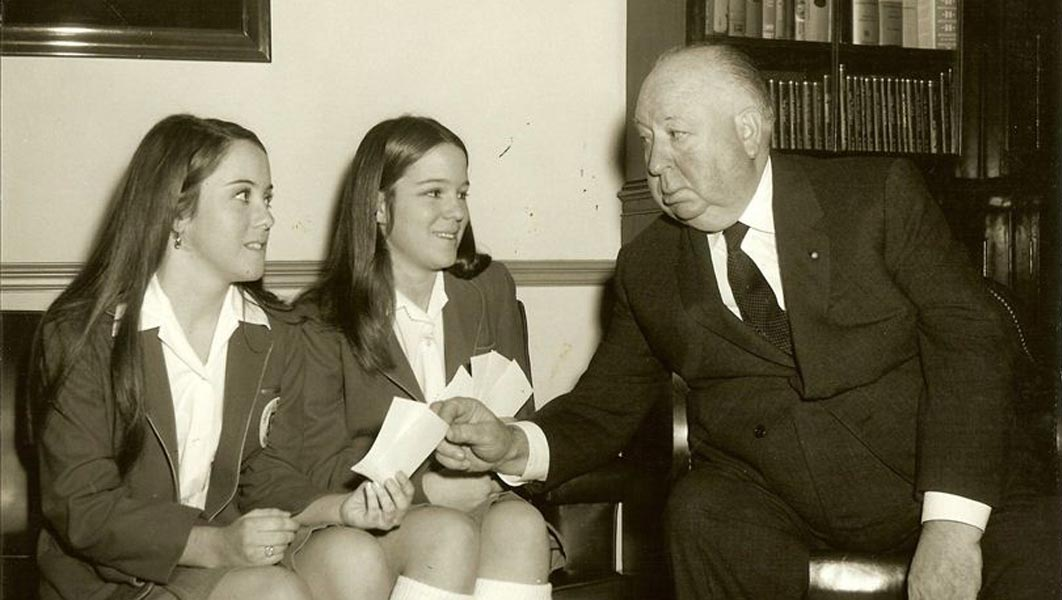 Alfred Hitchcock pictured with his granddaughters, Tere Carrubba and Mary Stone.