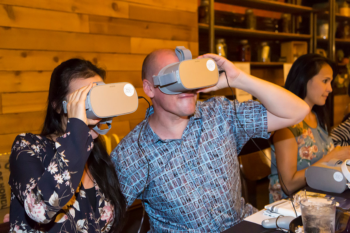 Rick Kinsel dons a virtual reality headset for Jenny Dorsey's presentation of Asian in America.Photo courtesy of Rae Huo.