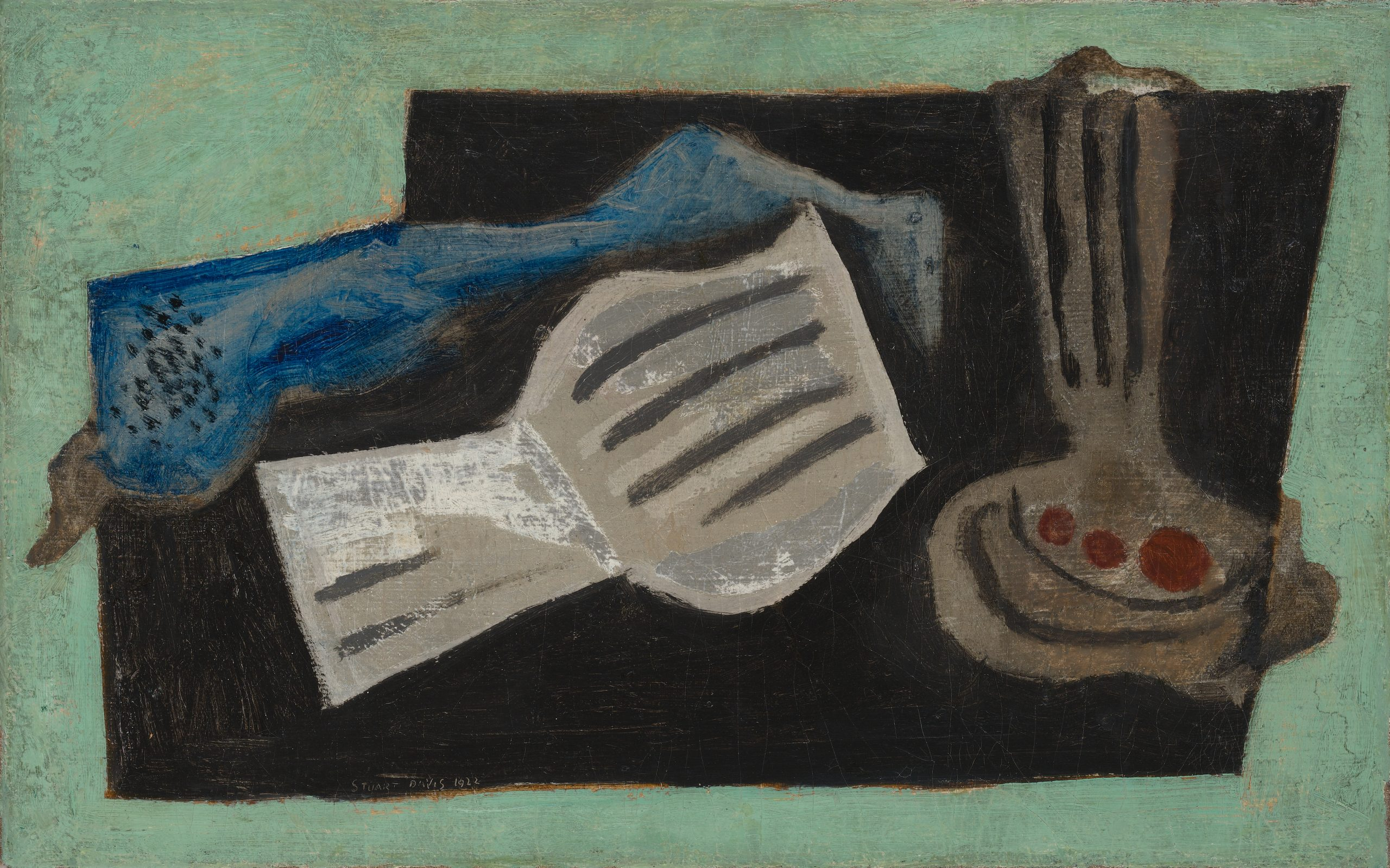 Still life featuring a flattened vase, open book, and blue fabric on a black and green background.