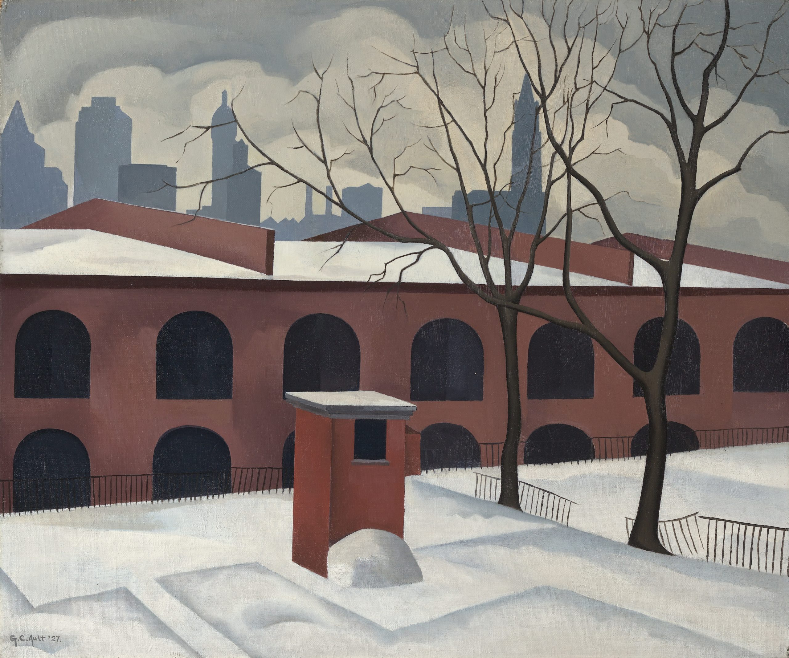 Snowy landscape in front of a wide brick building with rows of black arched windows, with the New York skyline in silhouette against a cloudy sky.