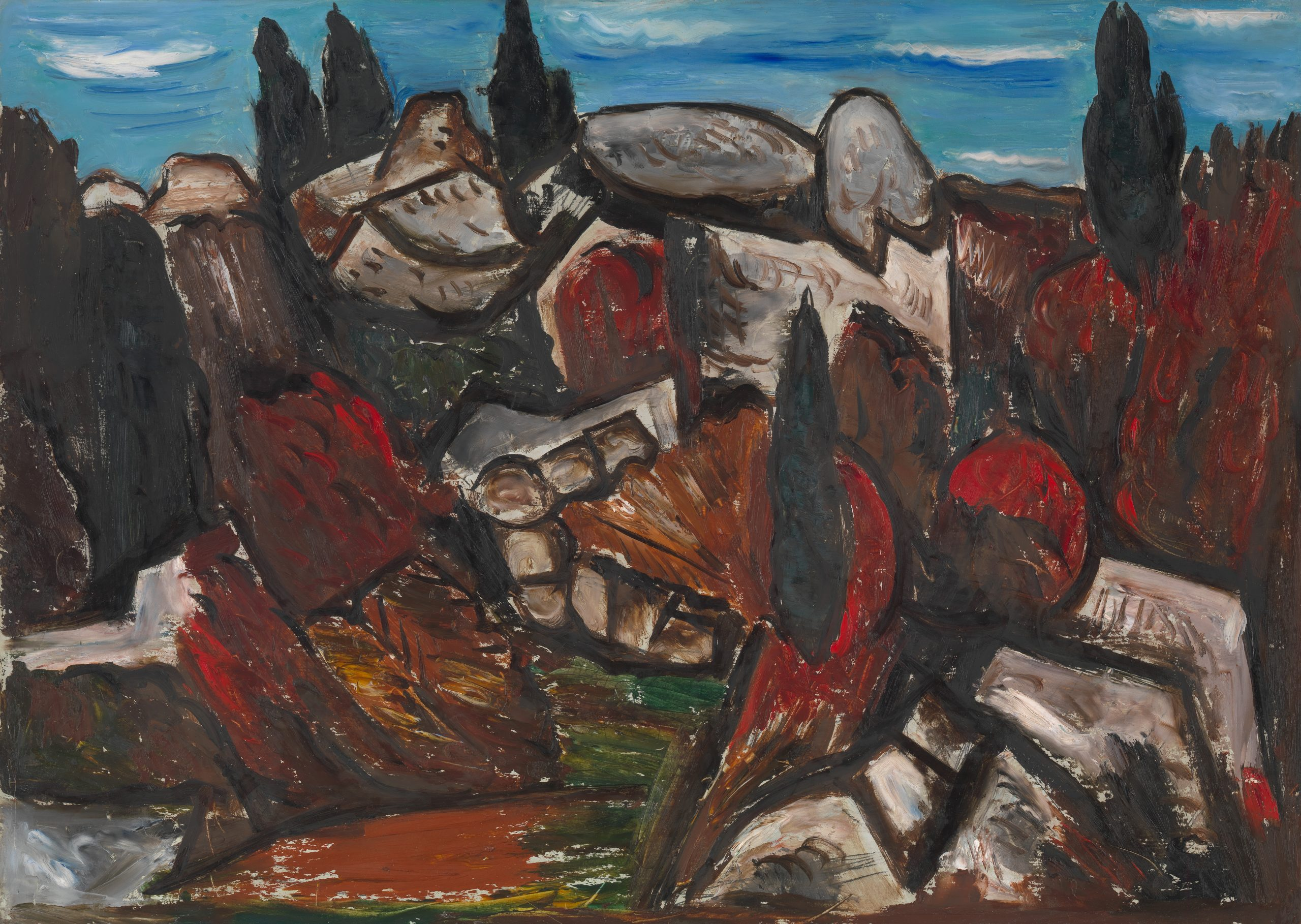 Hill of rugged rocks interplaced with a red and green thicket against a blue sky.