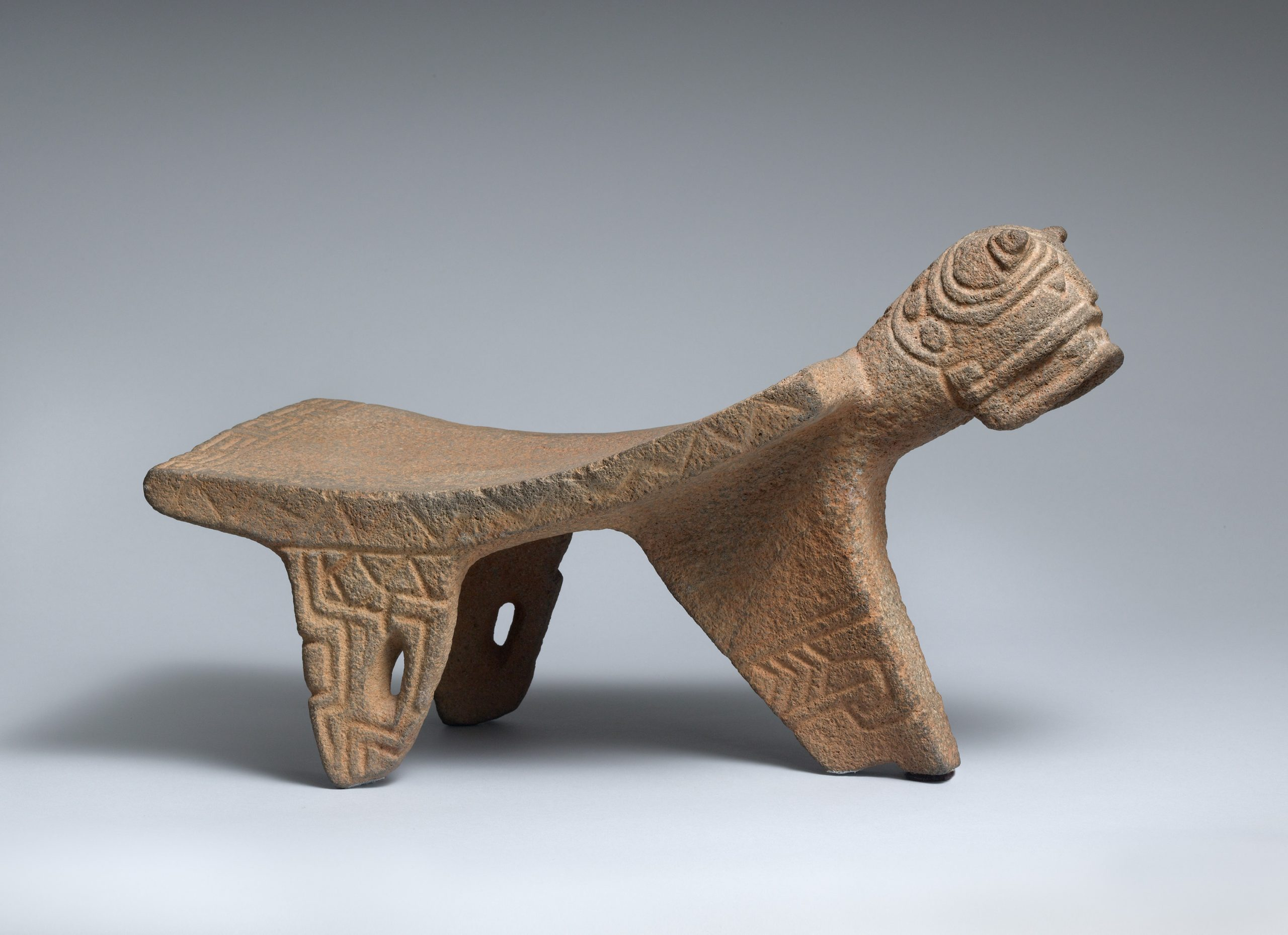 Stone metate carved to resemble a jaguar.