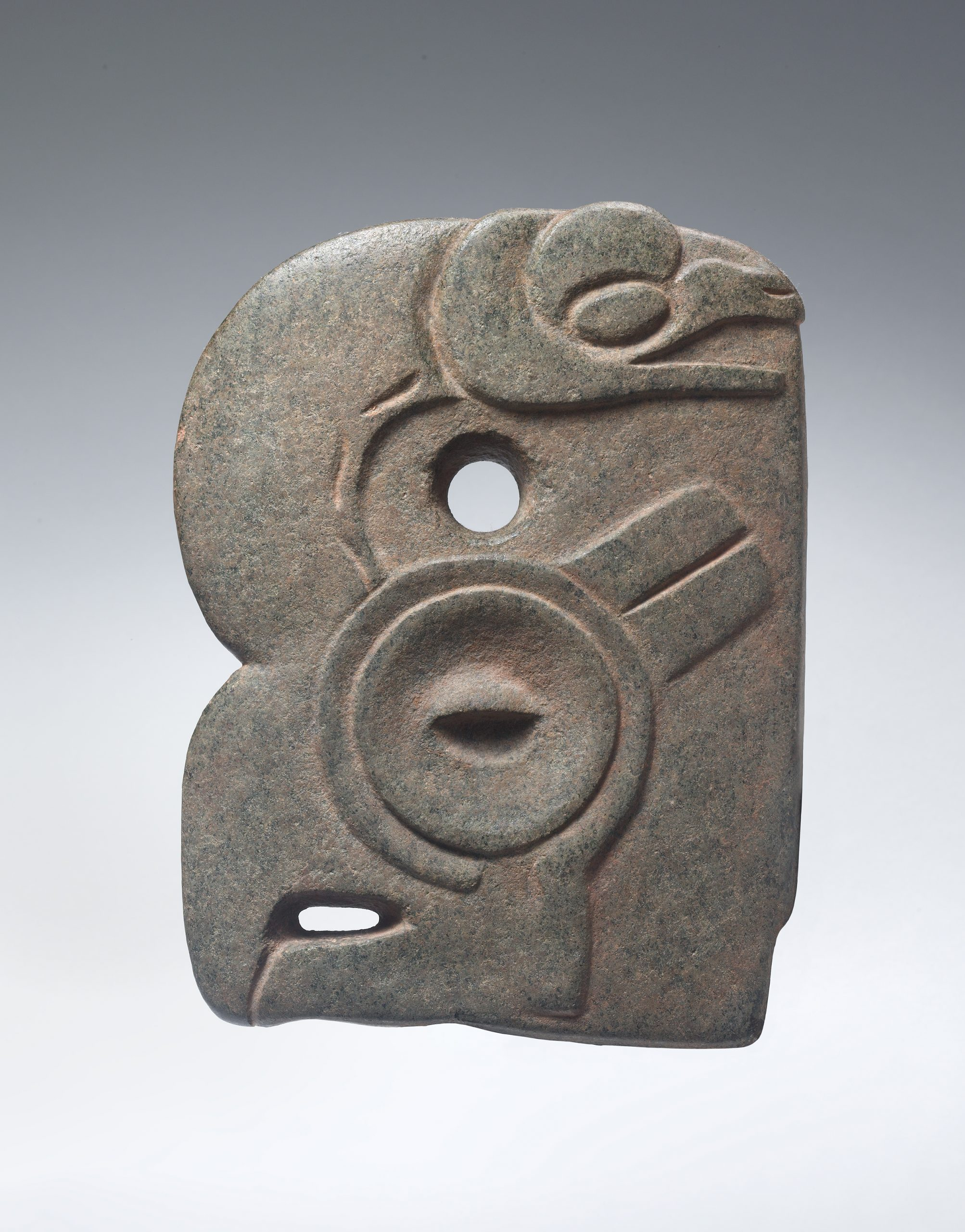 Small abstract stone figure with indented facial features features, a large pointed nose, and arms resting on its mid-section.