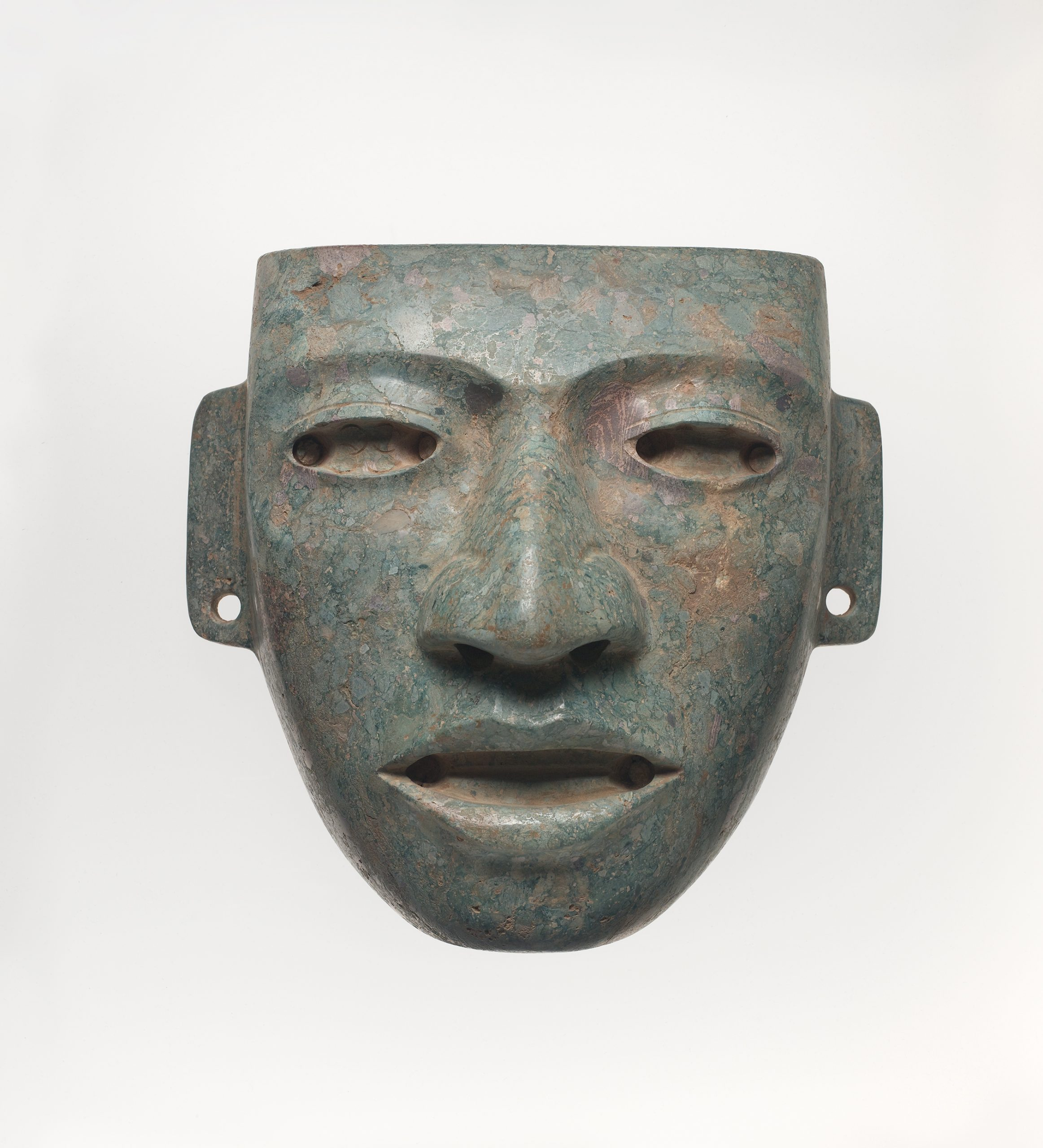 A naturalistic mask with large eyes, a broad pointed nose, and open mouth.