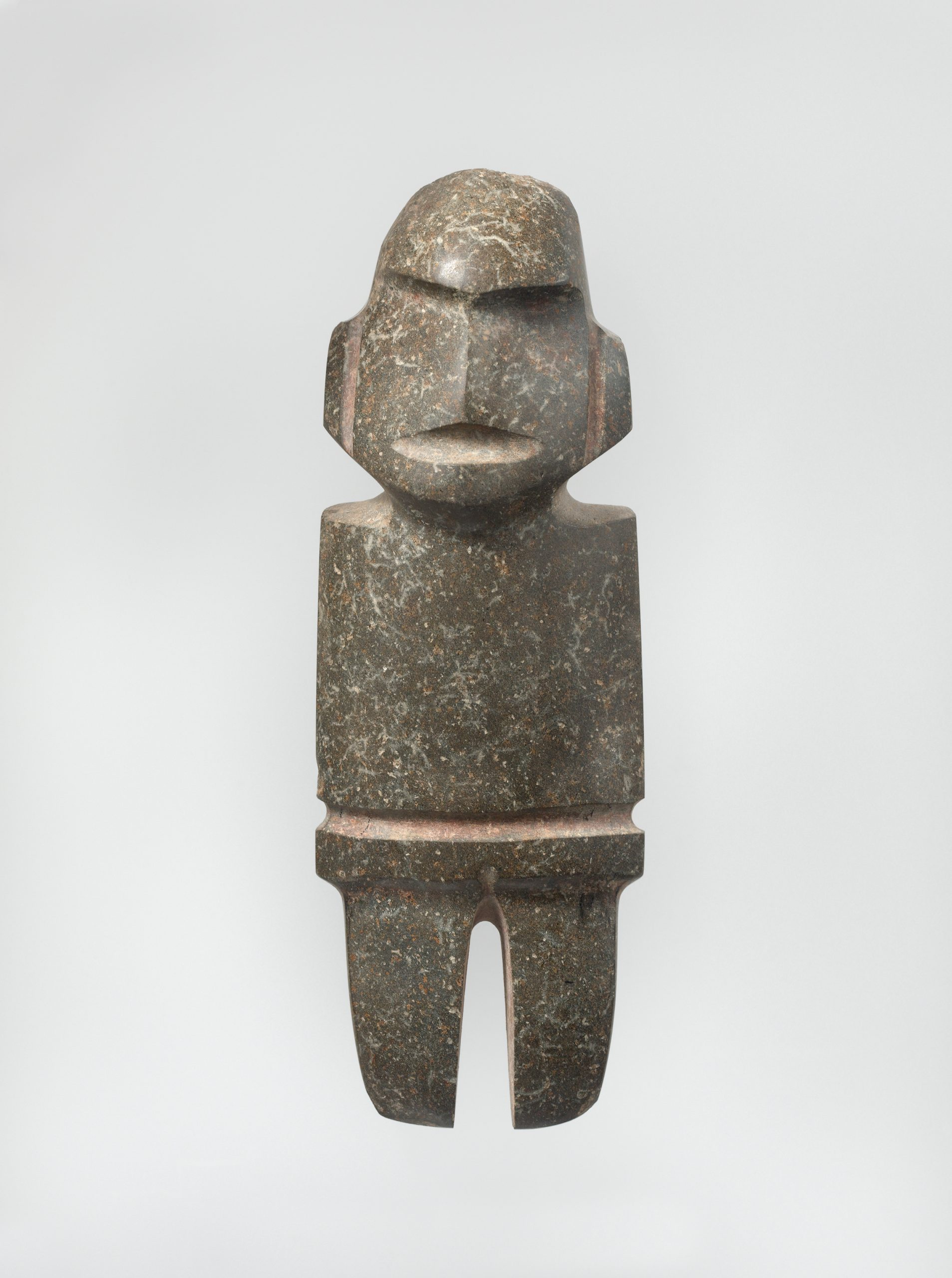 Abstract standing figure with no arms and indented features to represent facial features.