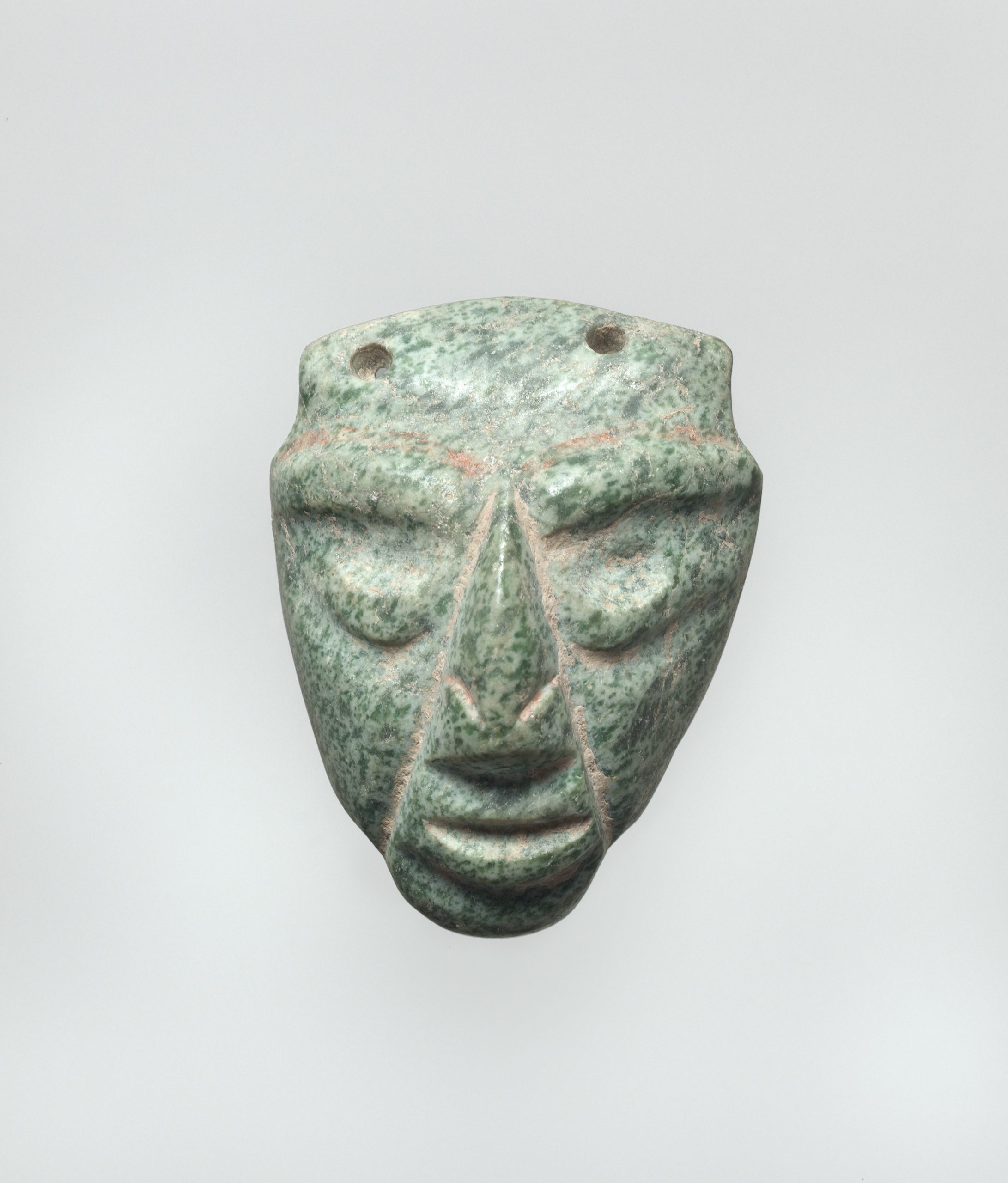 Vessel with stylized relief of two identical human heads on either side.