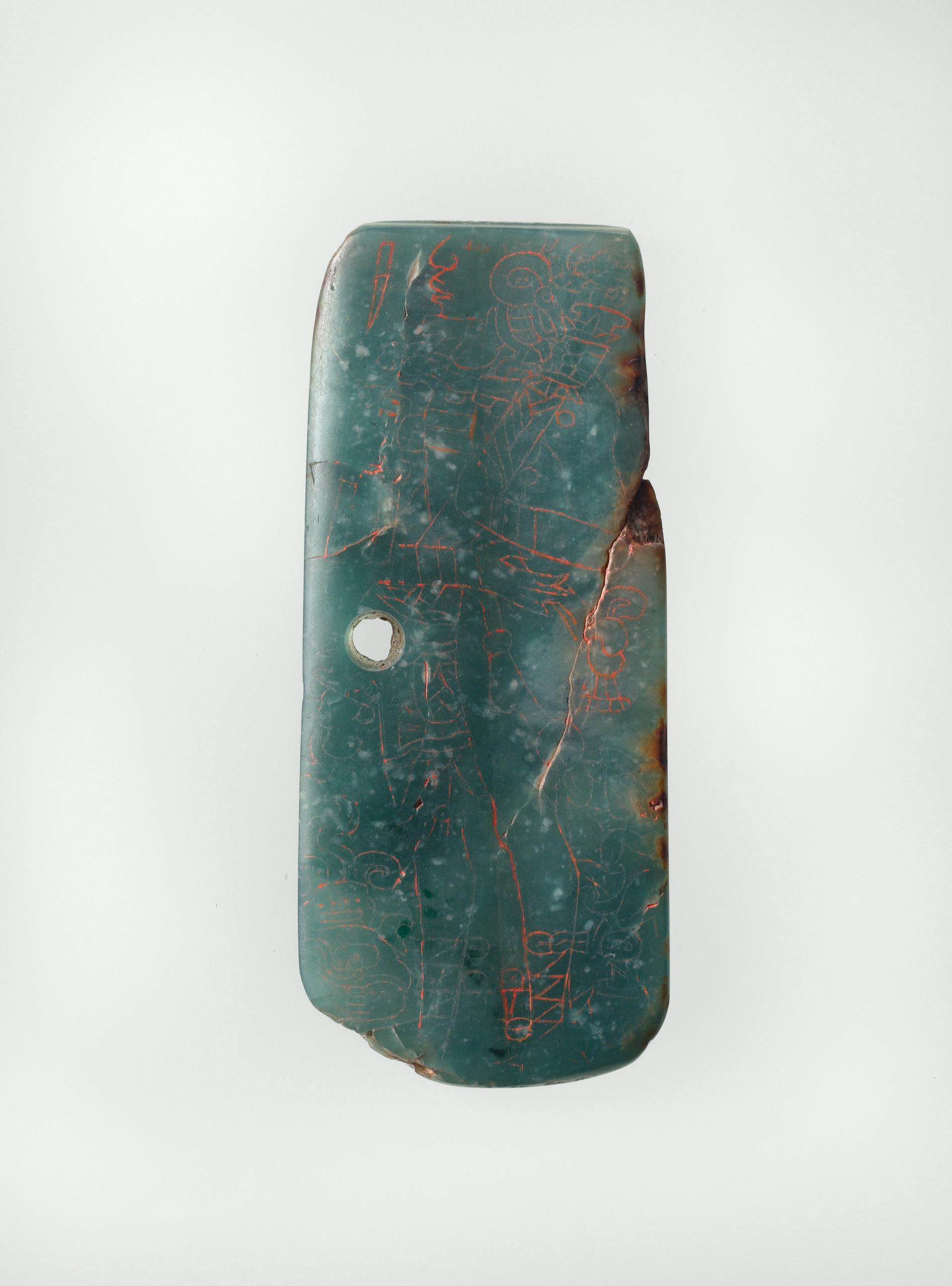 Jade green plaque with incised images of Mayan dignitary figures.