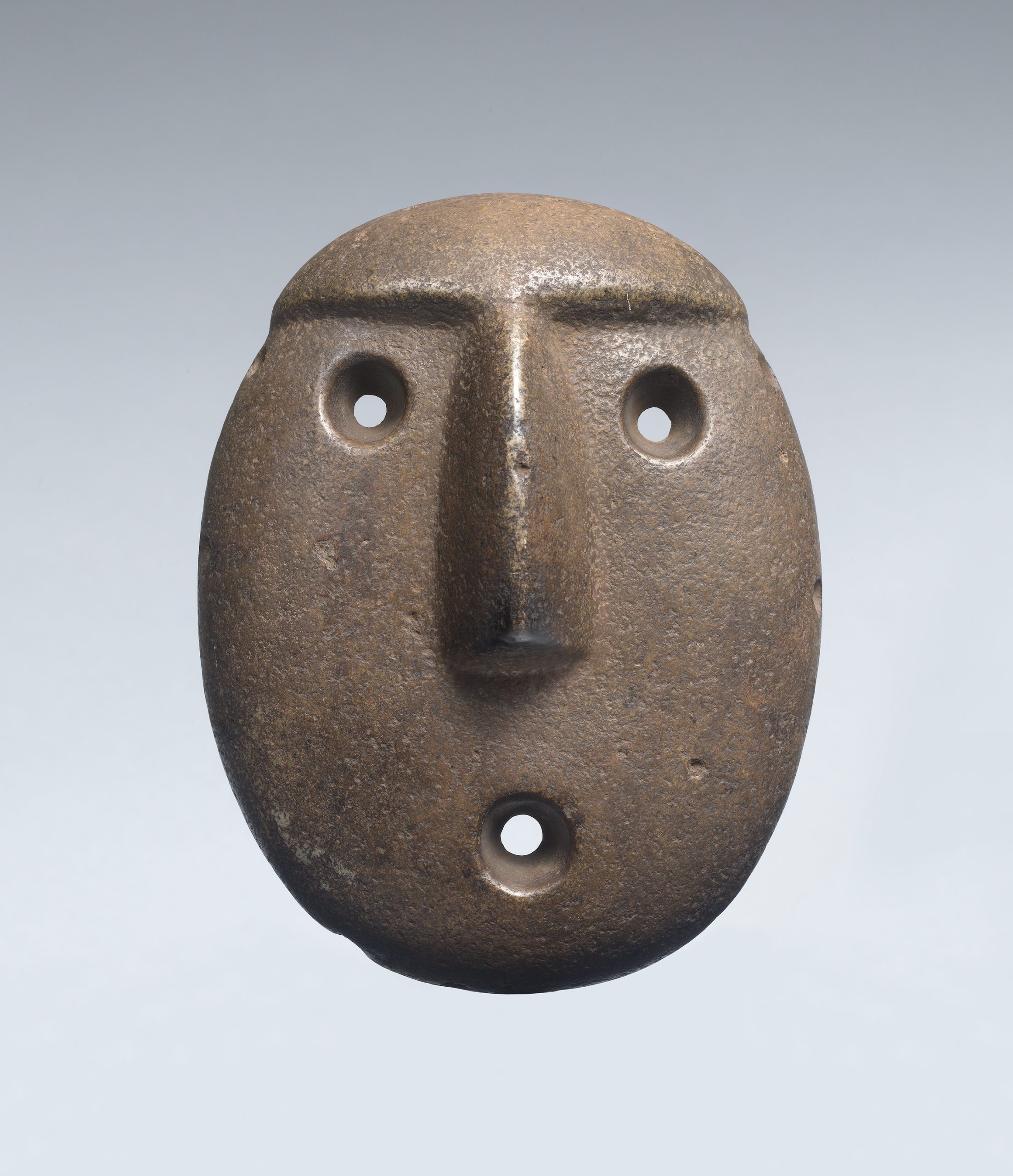 Face mask with large eyes, a prominent nose, open mouth, ear spools, and extended tongue.