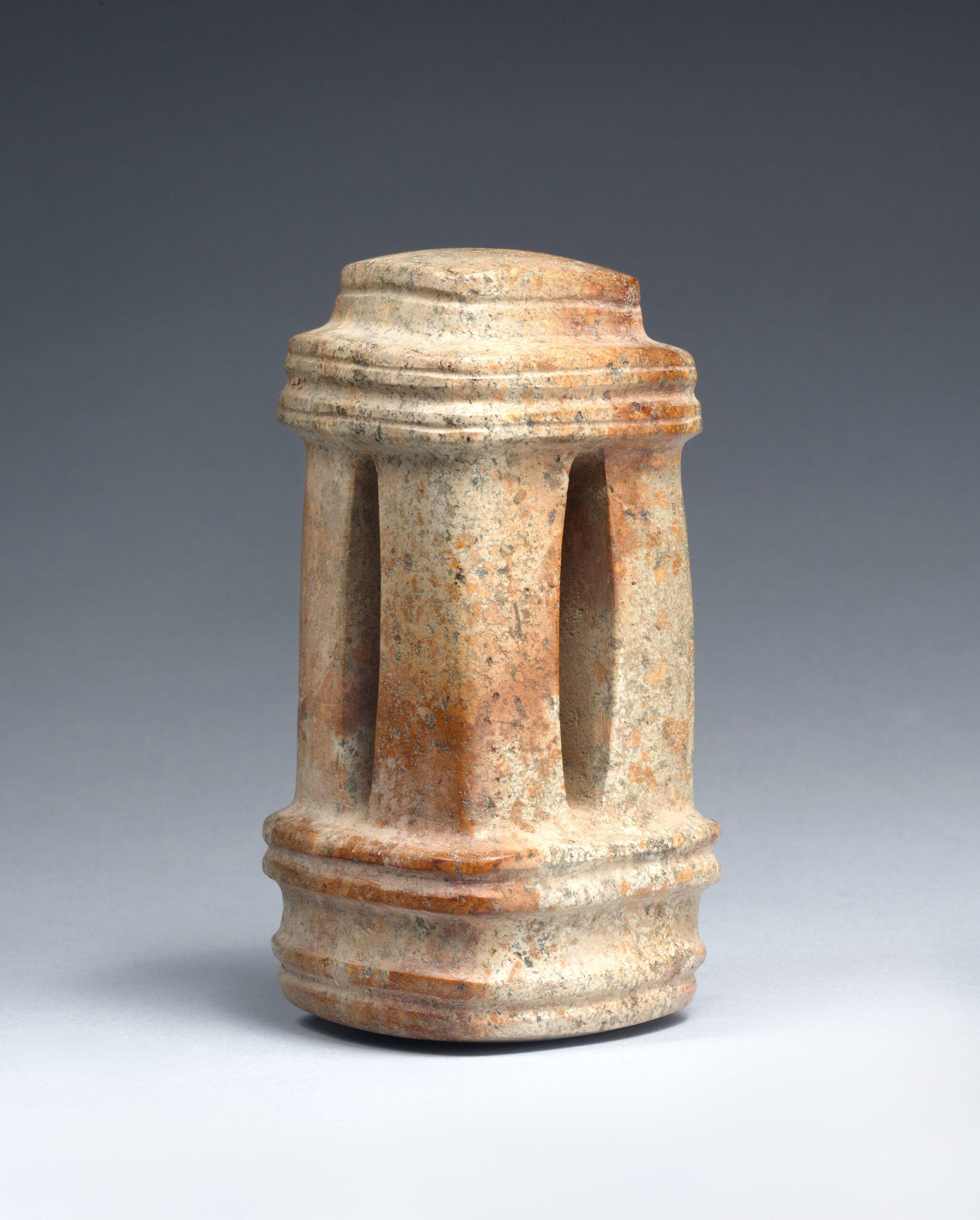 A black stone four column temple.