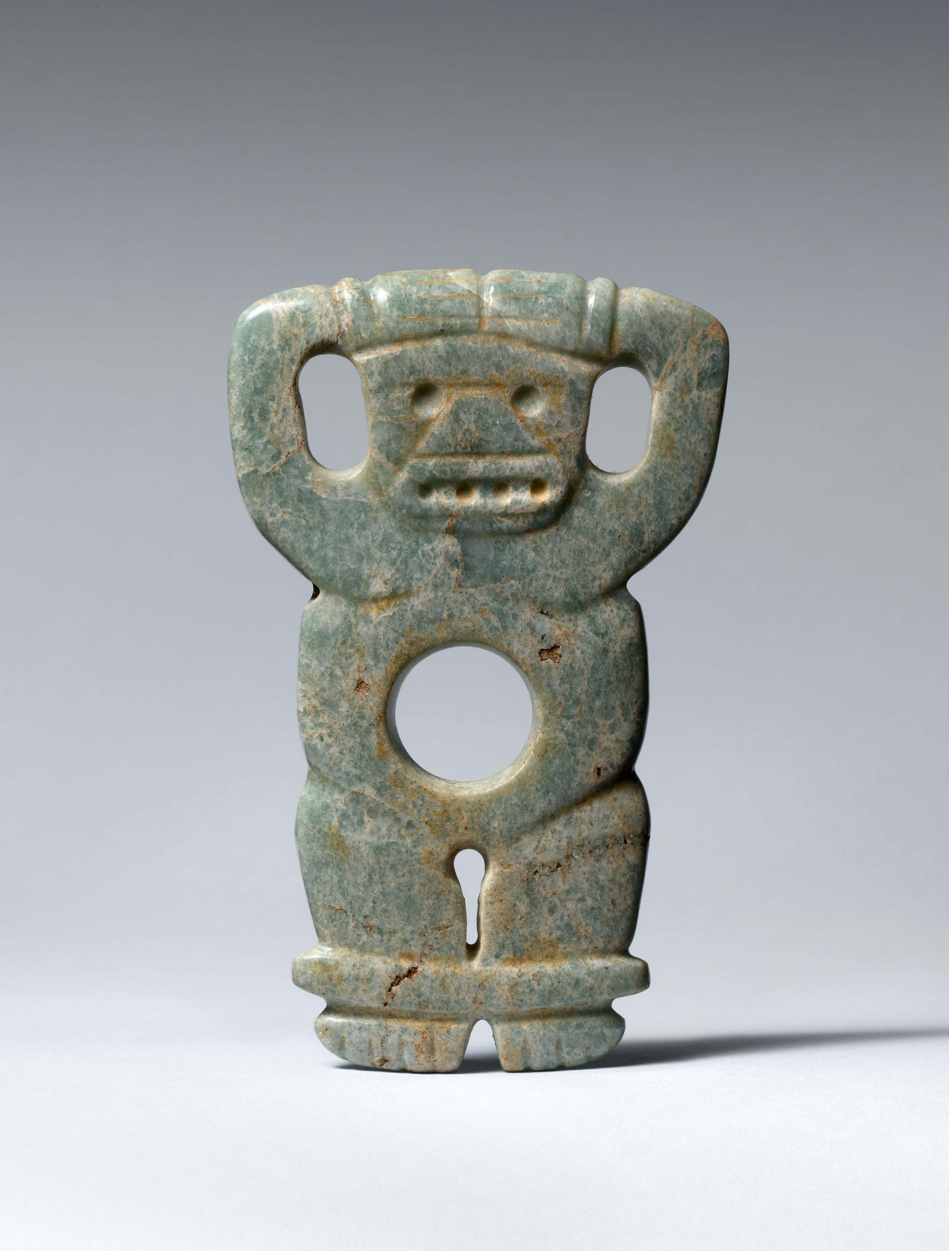 Abstract stone standing figure with human and animal characteristics.