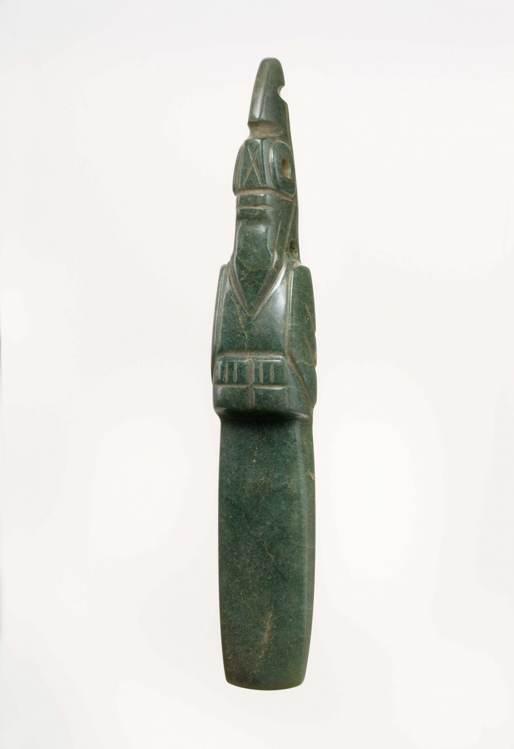 Green celt with the handle carved in the shape of a parrot.