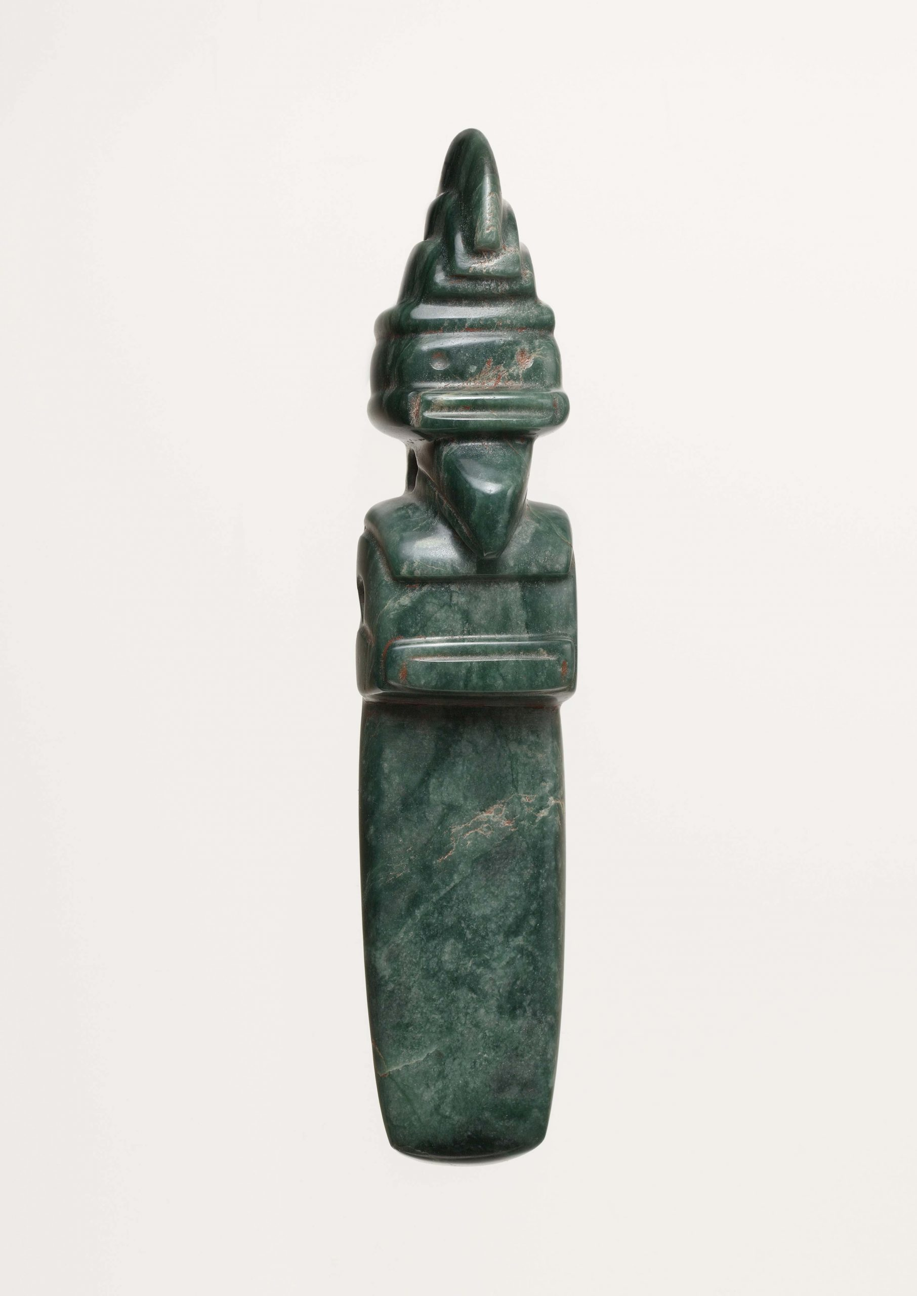 Dark green stone sculpture of a Costa Rican bird wearing a crown.