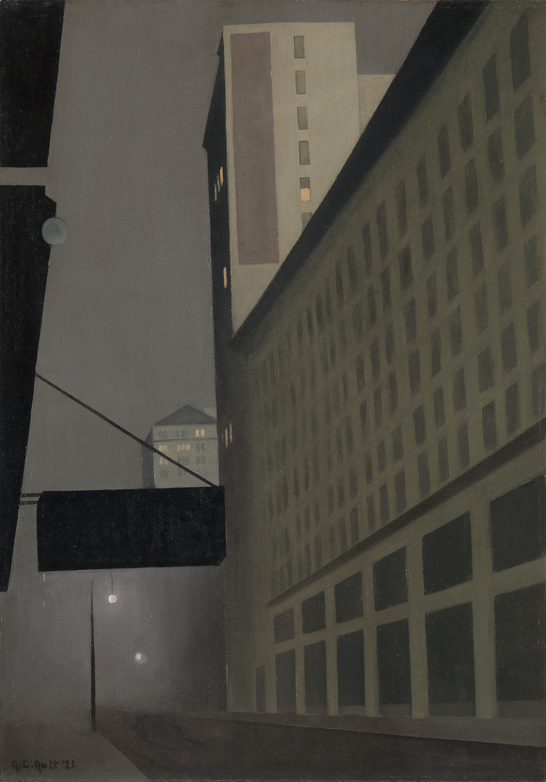 City street scene at night featuring tall buildings and a foggy street dimly lit by streetlights.