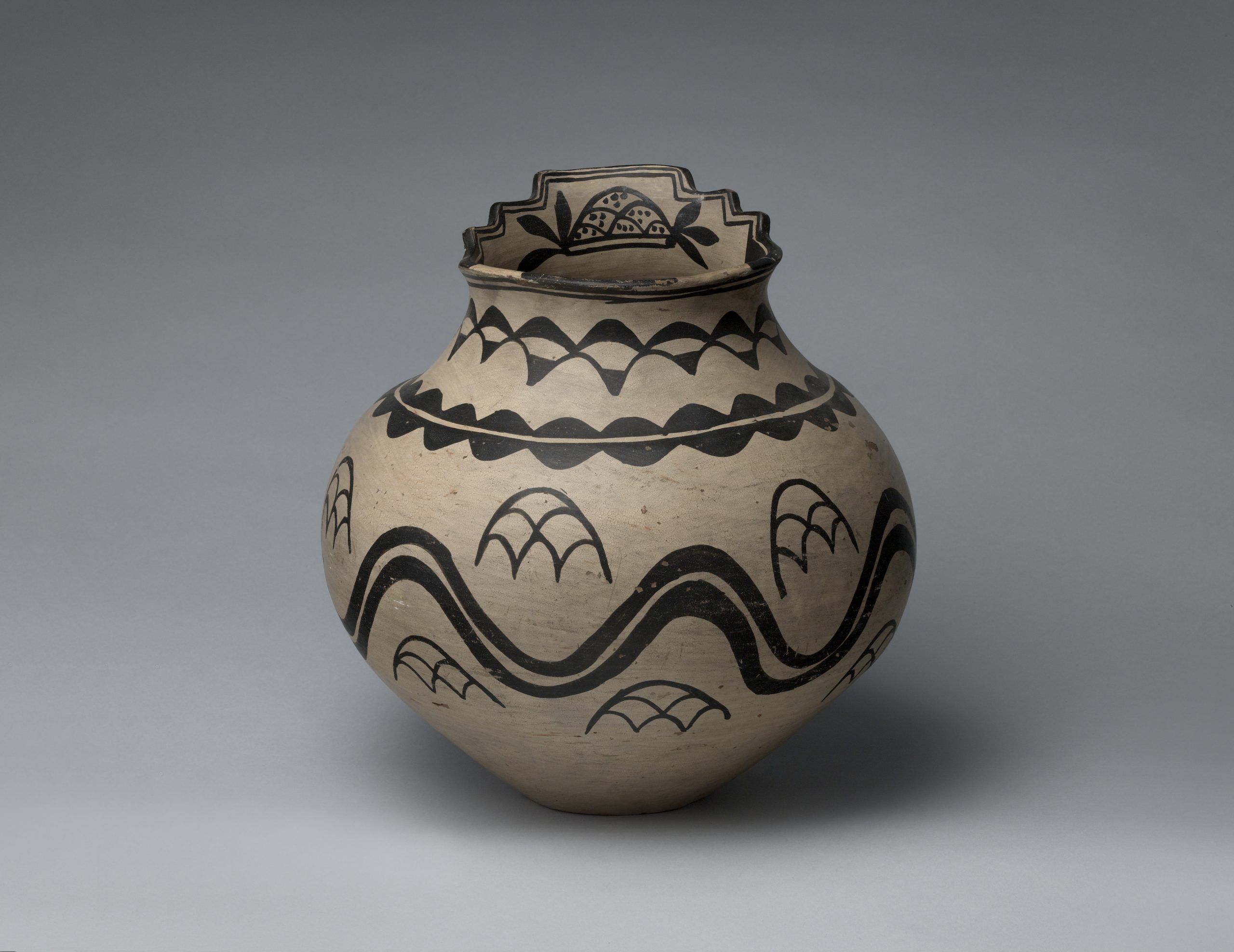 A San Ildefonso pot with a stepped lipped.