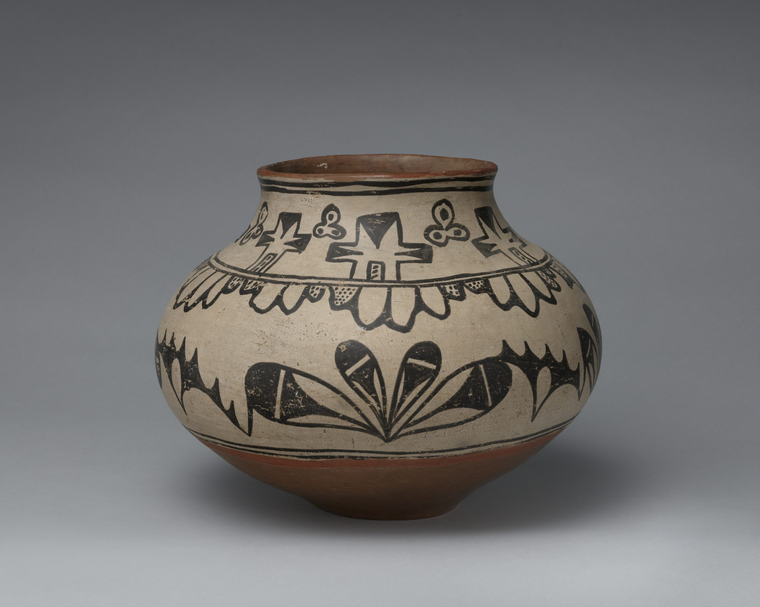 A Tesuque jar with black designs.