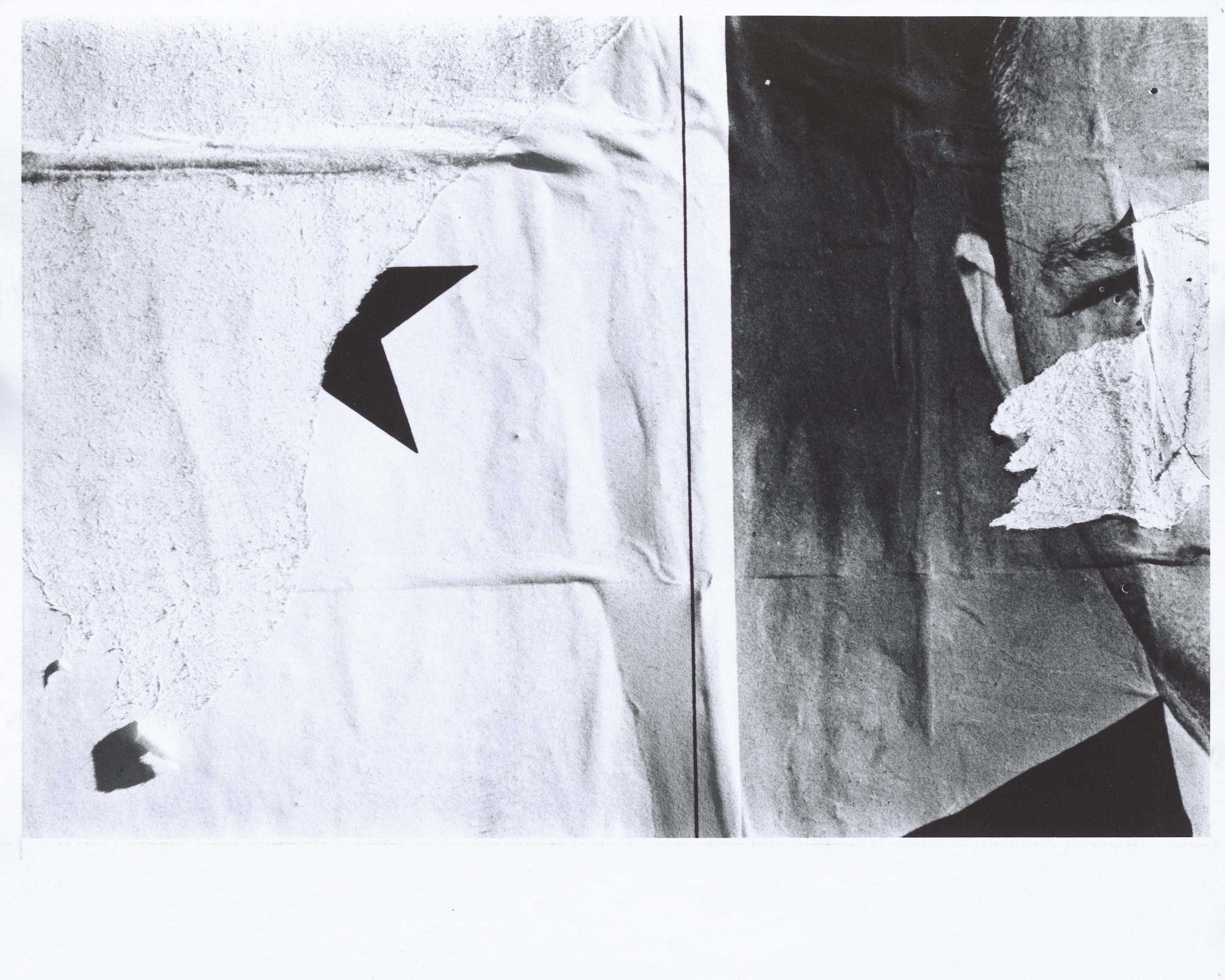 Black and white photograph of layered torn signs featuring portions of a star and a man's face separated by a vertical line.