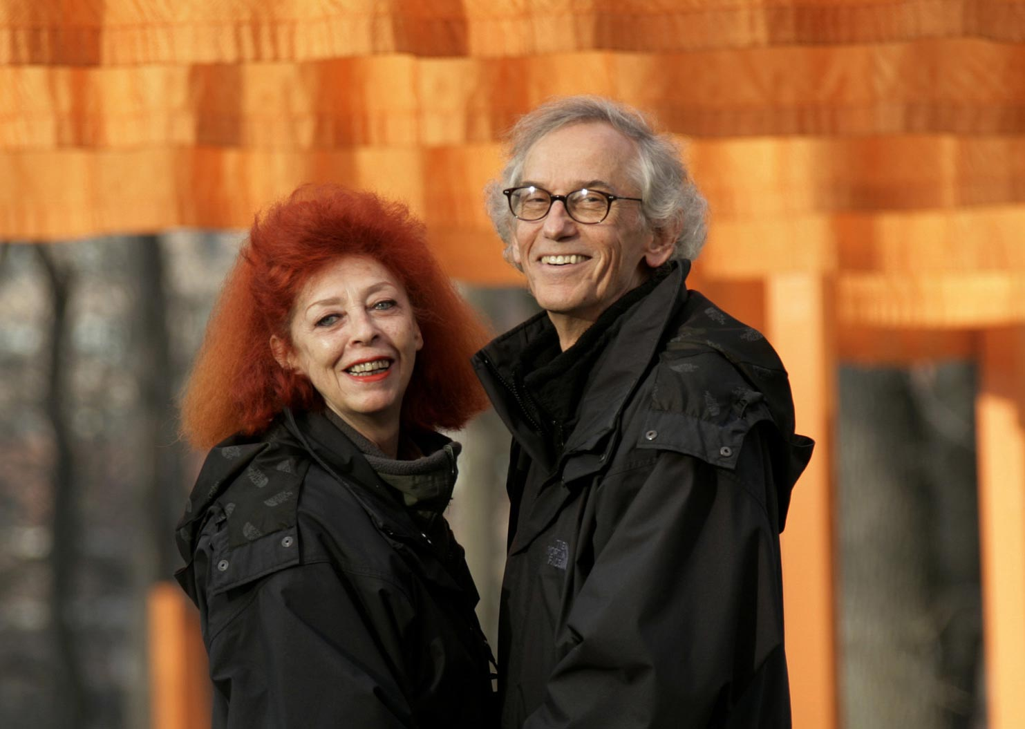 Christo and Jeanne-Claude stand in front of their work of art