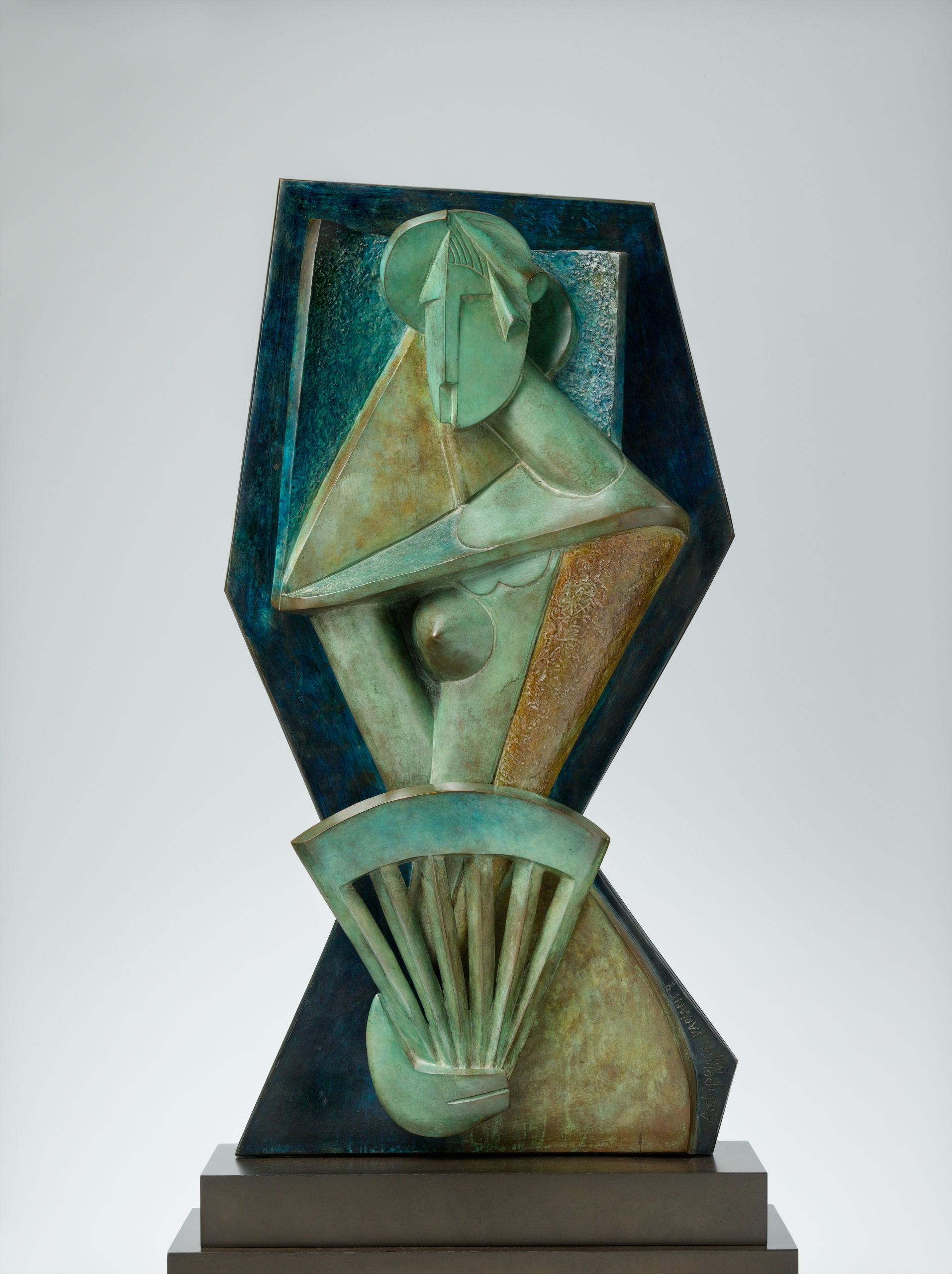 A geometric light-green bronze figure of a woman holding a fan, edged with dark blue.