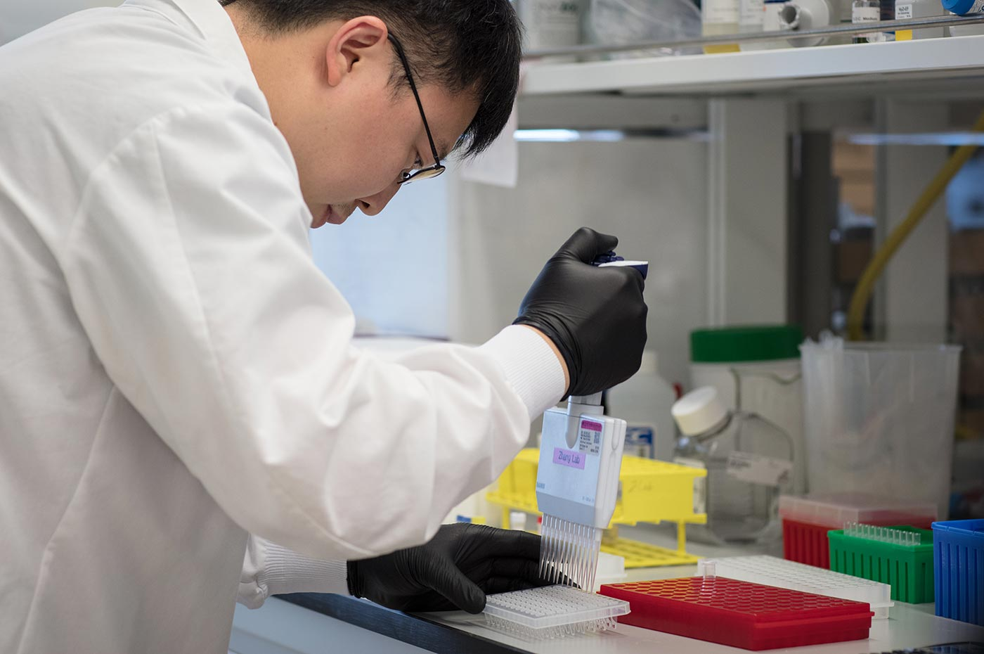 Feng Zhang at a bench in his lab