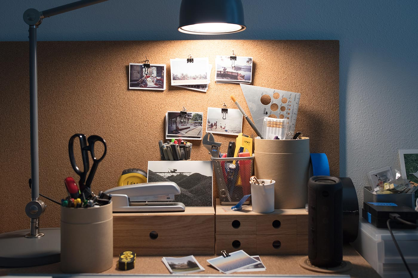 Architectural photos and tools on James Leng's desk.