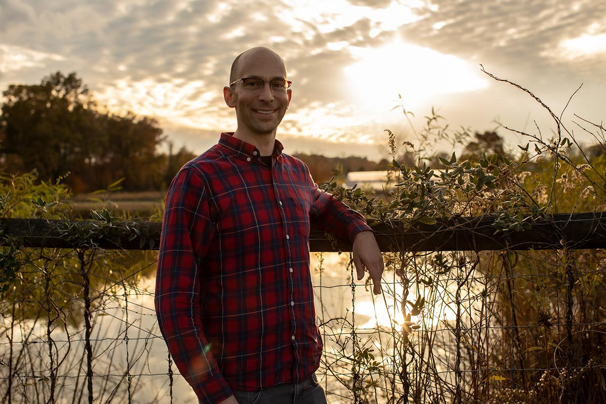 Standing in front of a lake on a farm in New Jersey, Martin Jonikas is working toward environment-friendly food production and helping to combat climate change.