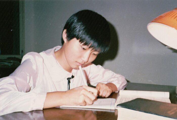 Xiaowei Zhuang studying in college.