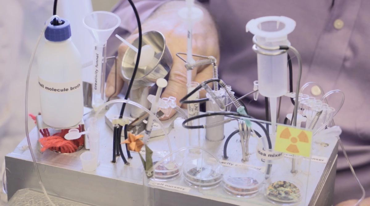 A close-up of laboratory testing equipment including multiple tubes, petri dishes, and syringes.