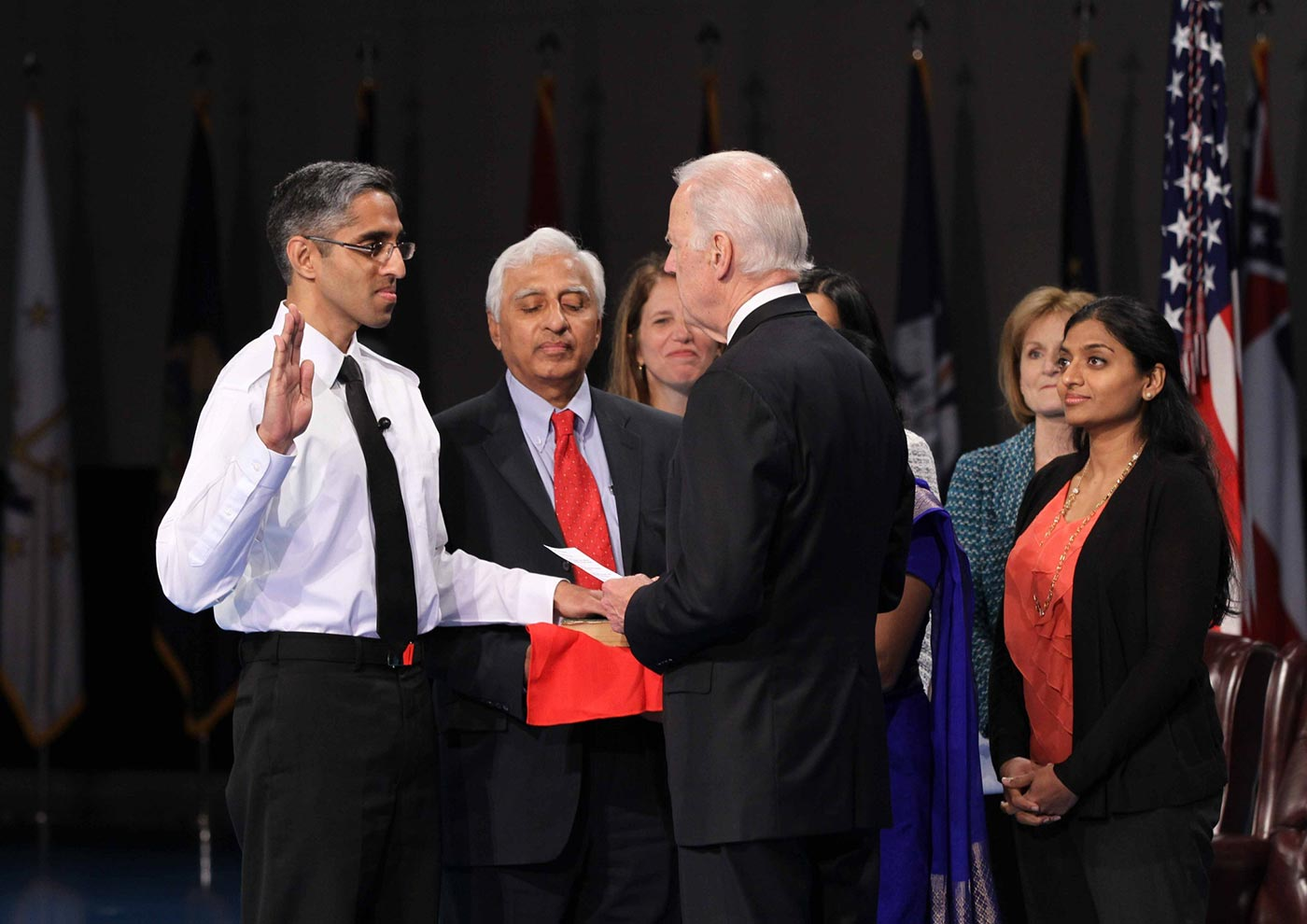 Vivek Murthy, with hand on bible and other hand raised, is sworn in as Surgeon General of the United States.
