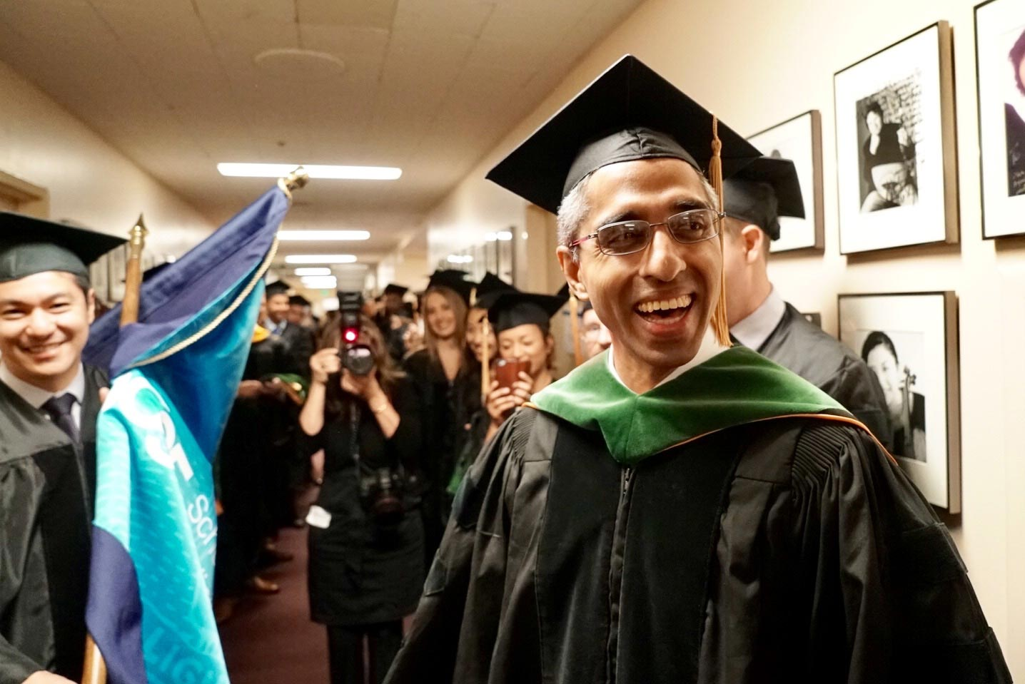Vivek Murthy smiles while dressed in his graduation cap and gown.