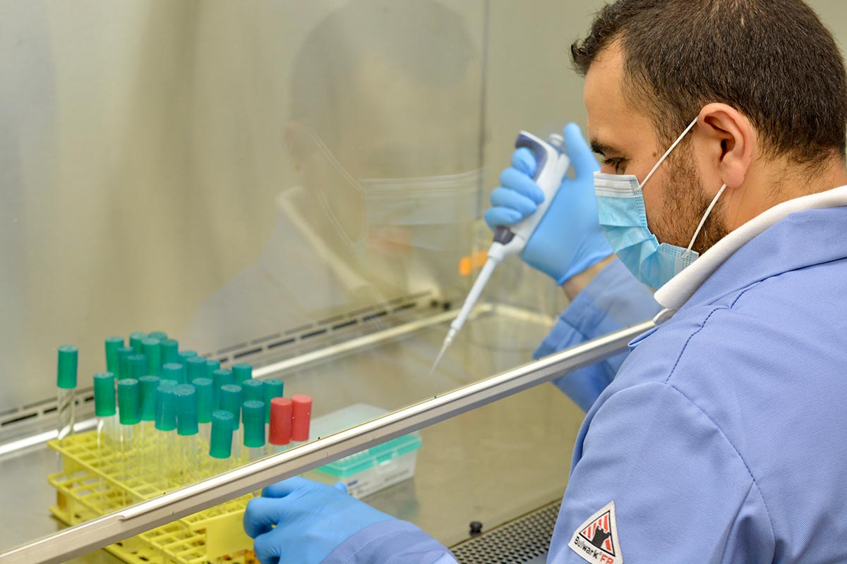 Mohamed Abou Donia conducting an experiment at a lab bench.