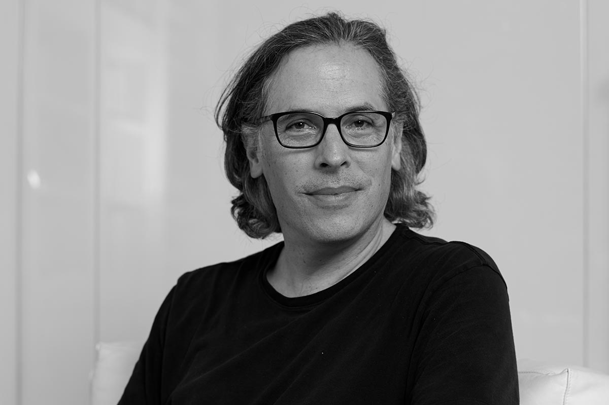 Black and white portrait of Rodrigo Prieto wearing a black shirt.