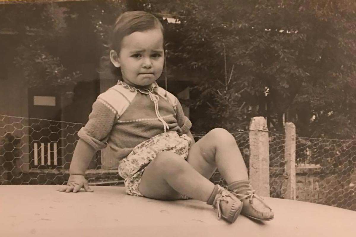 Silvi Rouskin, at age 2, sitting on top of a car.