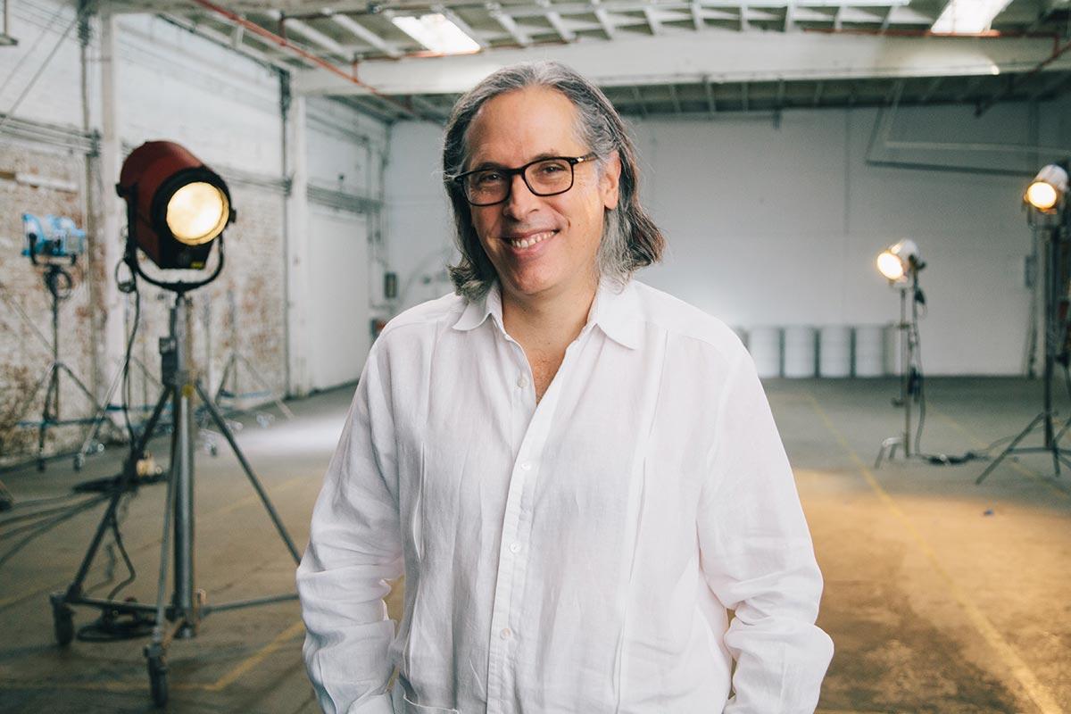 Rodrigo Prieto standing in front of film production lights.