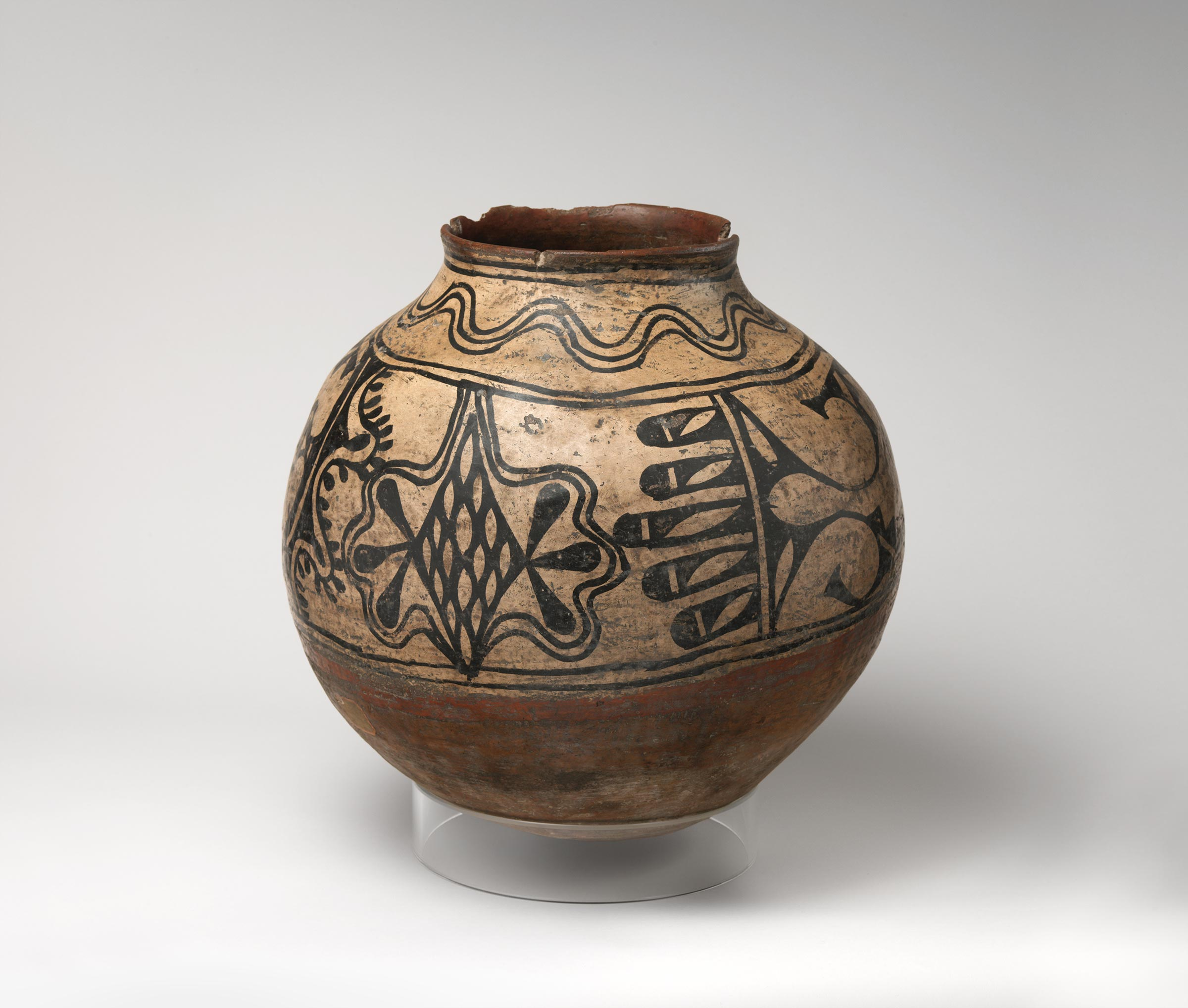 Cochiti polychrome storage jar featuring white slip with black and red painted decoration.