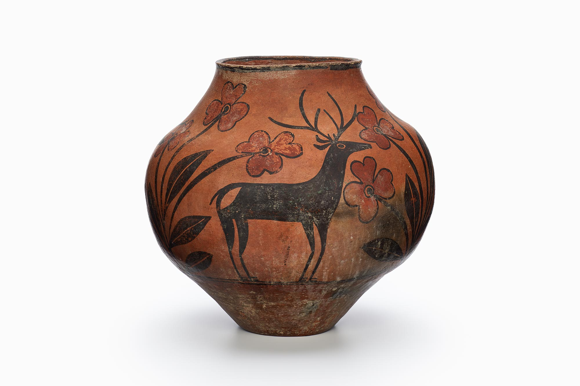 A Zia pot with a rarely-painted deer in the center surrounded by black and brown patterns.