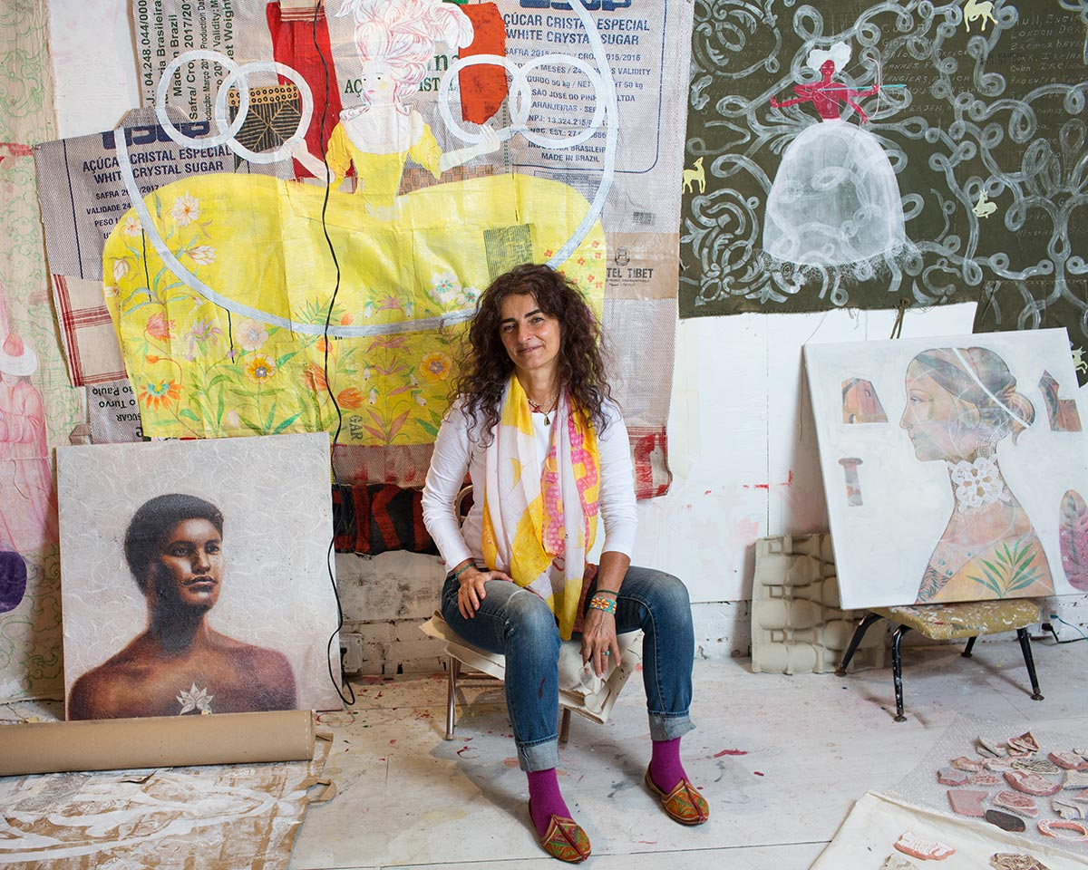 Michela Martello in her studio, surrounded by her artwork.