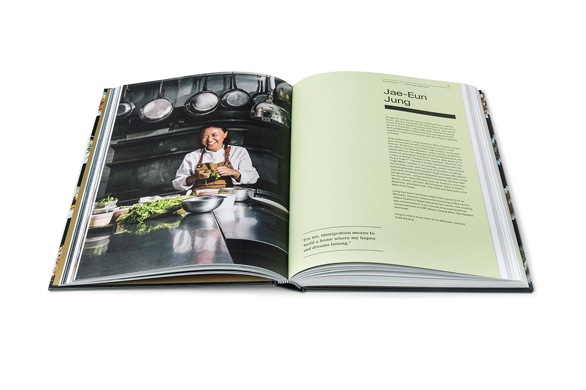 Interior view of A Place at the Table book featuring a photo of a chef in a kitchen