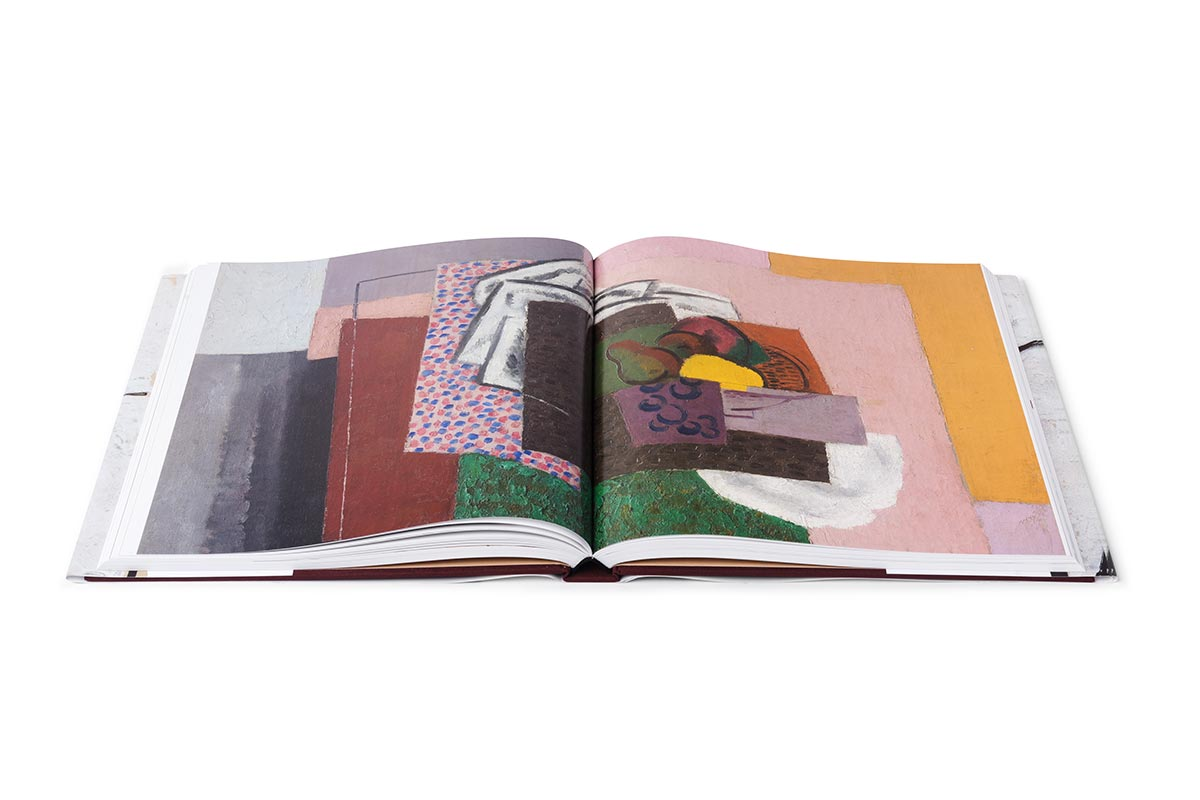 Interior view of the Masterpiece of American Modernism book open to a full page spread of artwork.