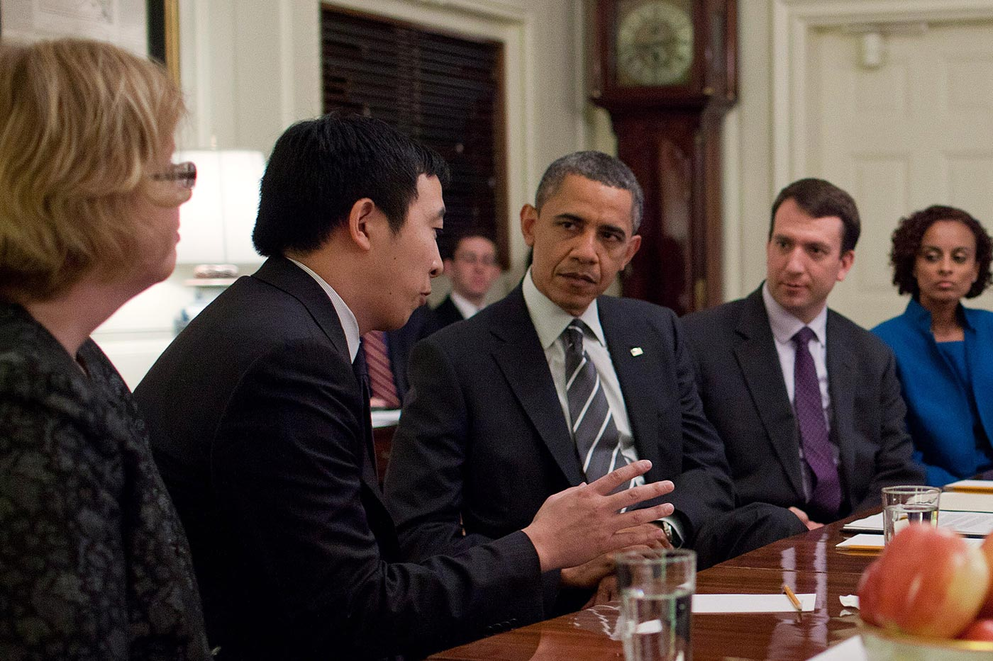 Andrew Yang speaks with former President Barack Obama at a table surrounded by Champion of Change colleagues.