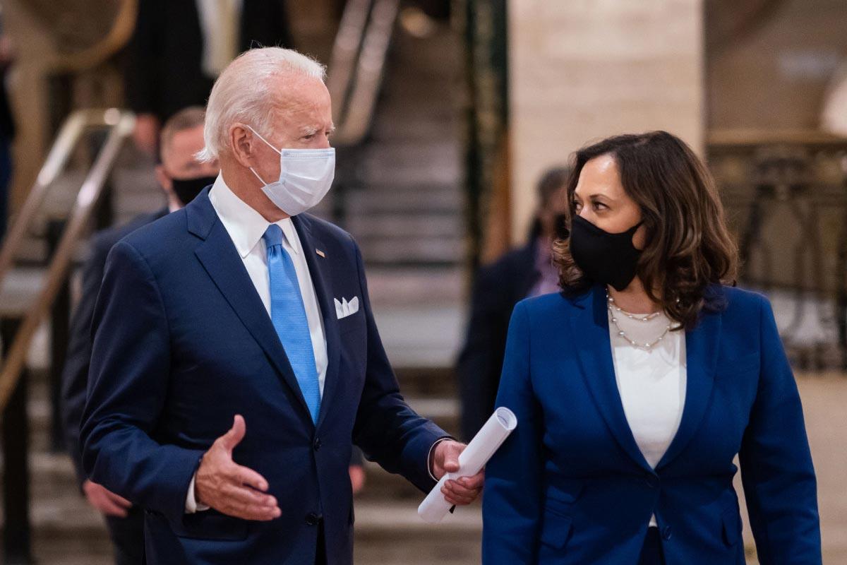 President Joseph Biden and Vice President Kamala Harris walking and speaking.