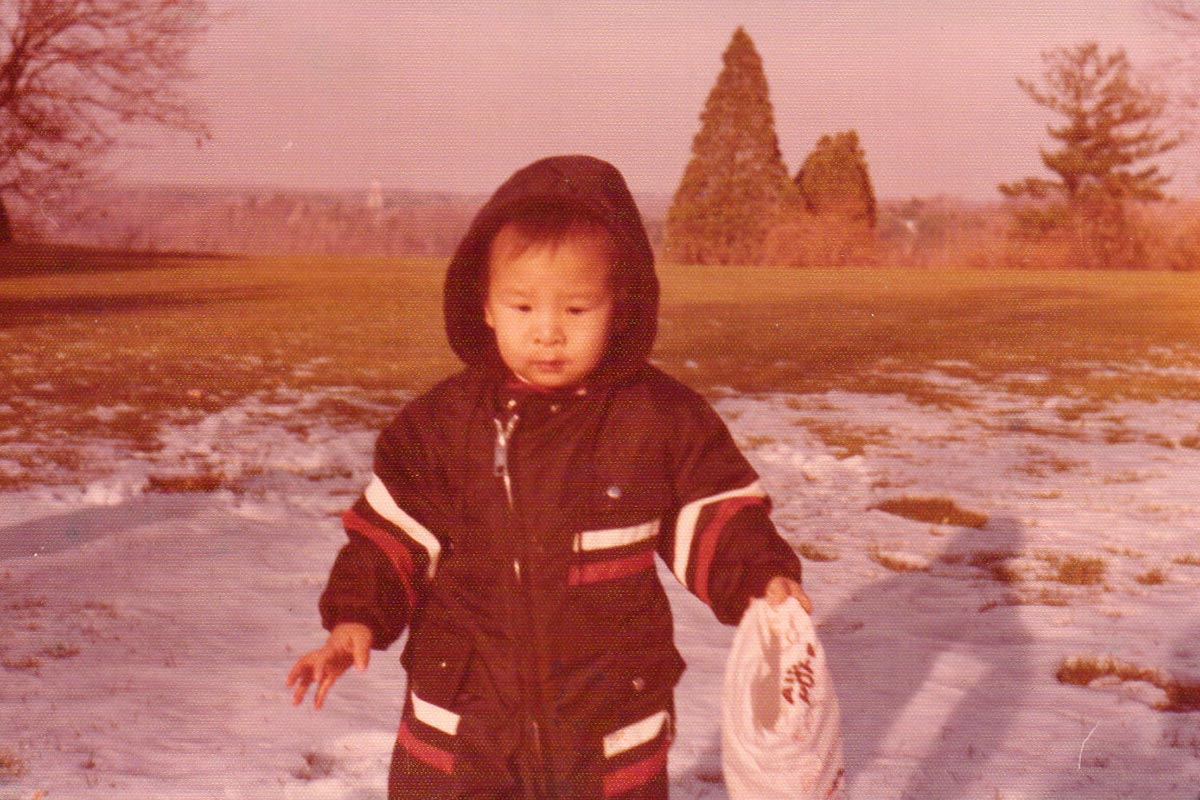 A photo of young Andrew Yang on a snowy hill.