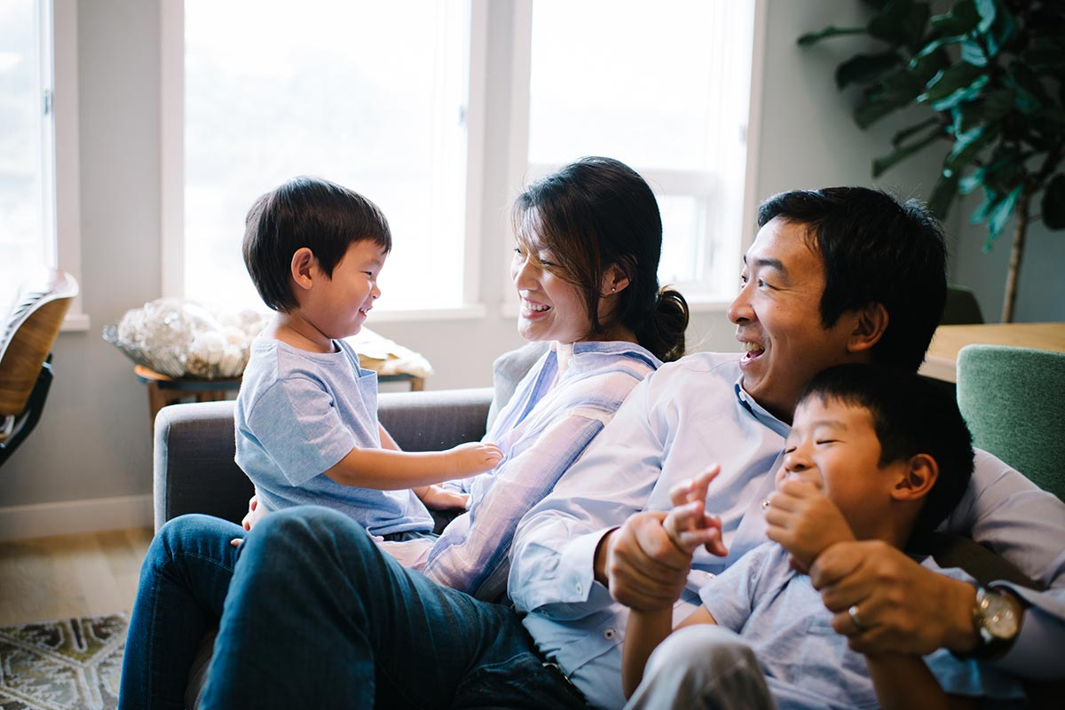 Andrew Yang with wife Evelyn Yang and their sons.