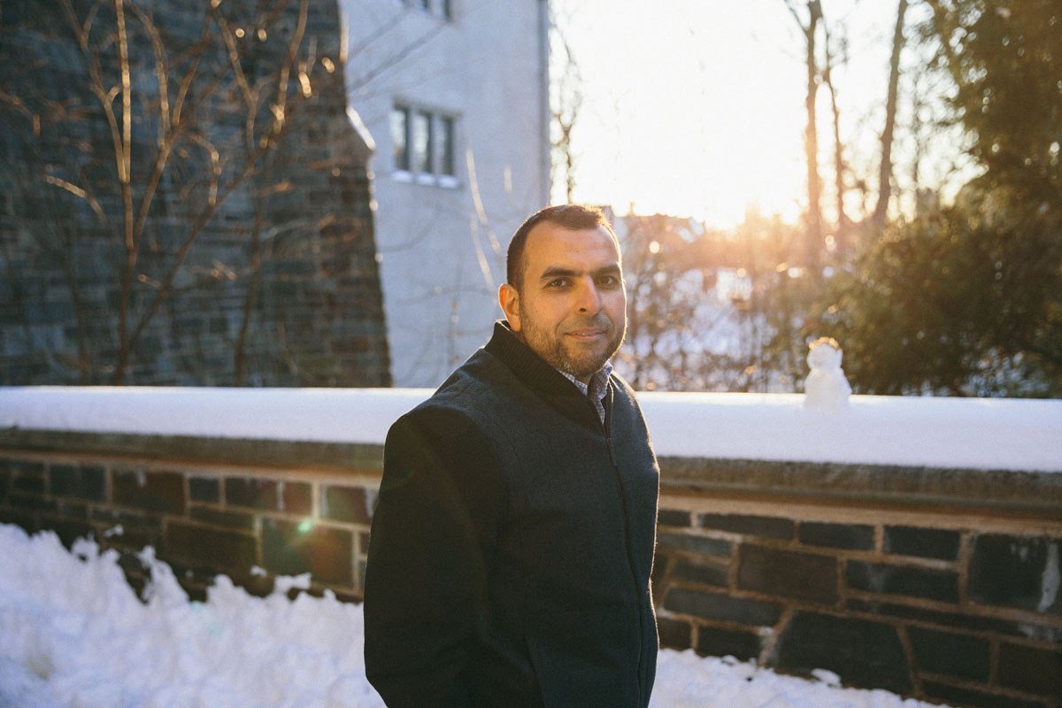 Mohamed Abou Donia stands in front of a snow-covered Princeton University building.