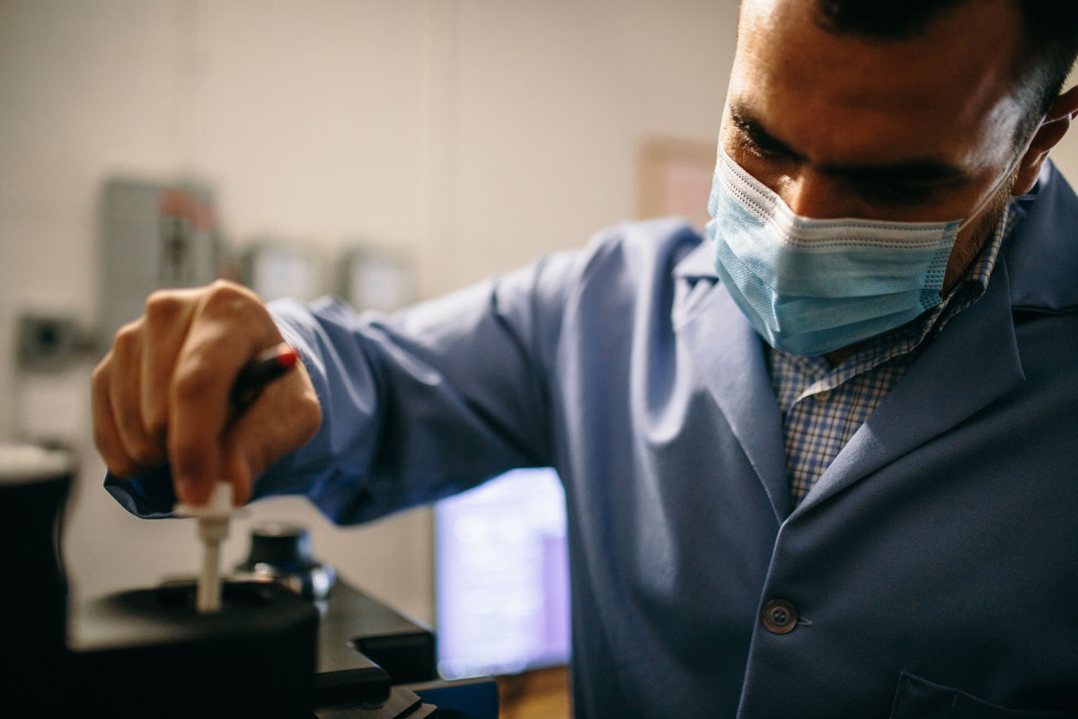 Mohamed Abou Donia testing a sample in his lab at Princeton University.
