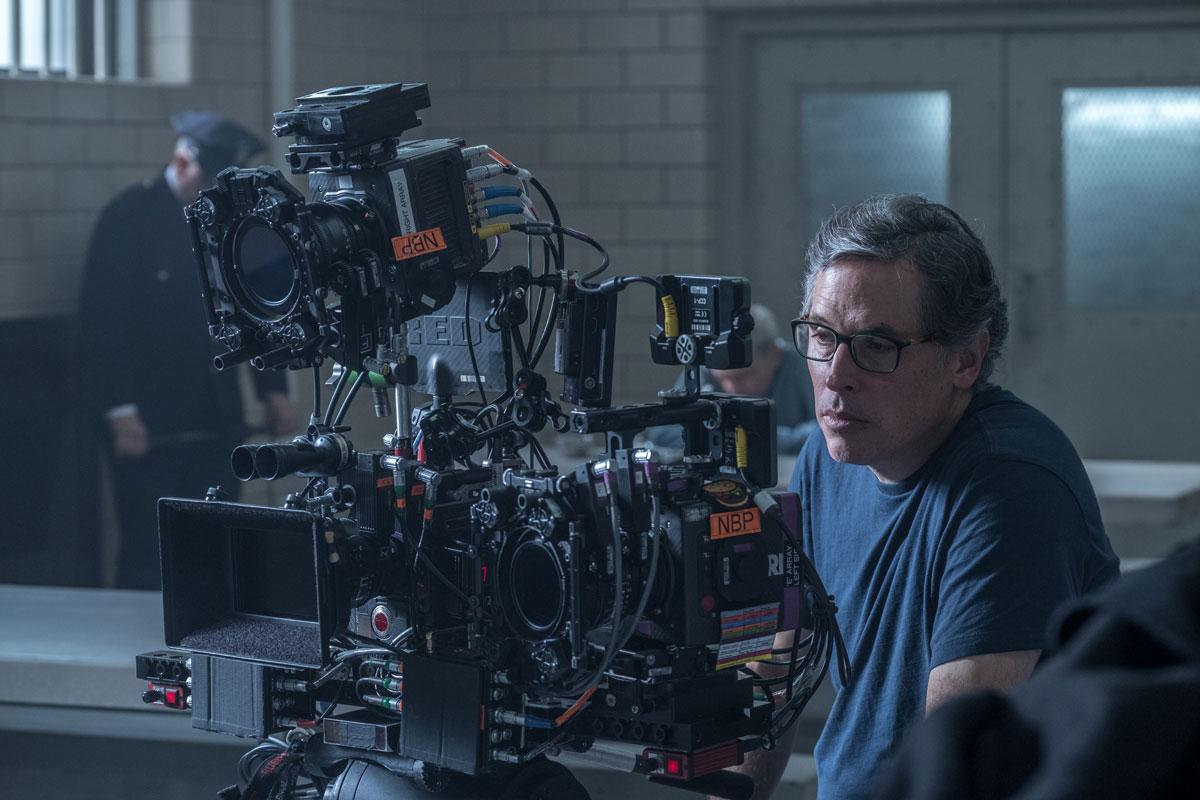 Rodrigo Prieto behind a high-tech film camera on the set of The Irishman.