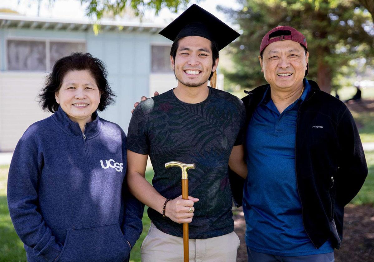 "Jirayut ""New"" Latthivongskorn at his Medical School graduation with his parents."