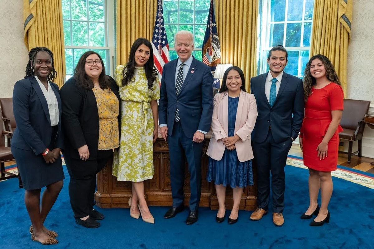 """Jirayut """"New"""" Latthivongskorn and colleagues at the White House with President Biden."""