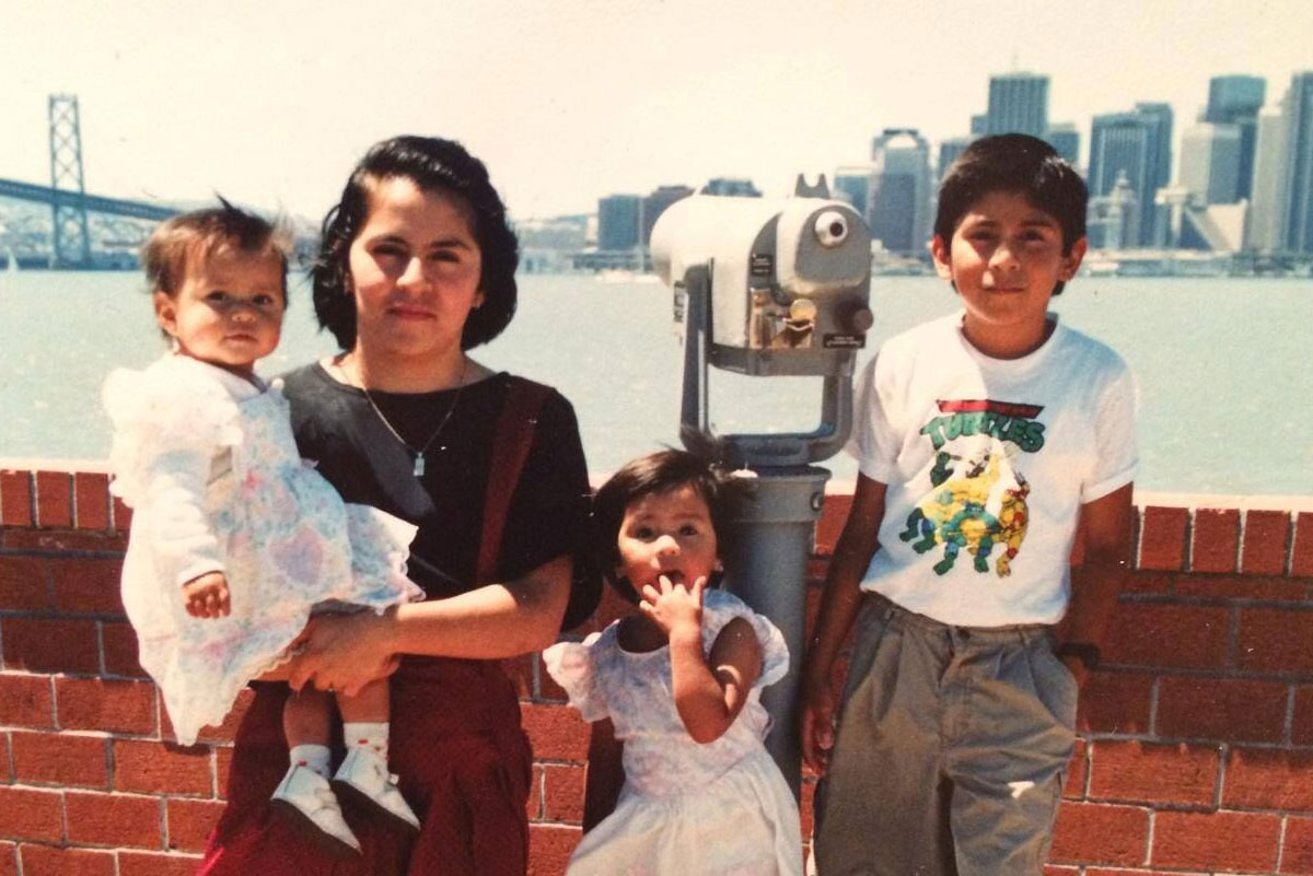 Denisse, her mother, and siblings with the skyline in the background.