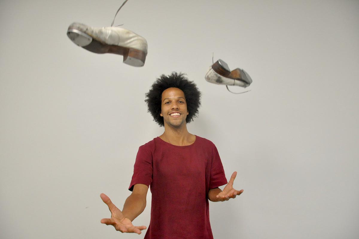 Leonardo Sandoval tosses tap dance shoes in the air.