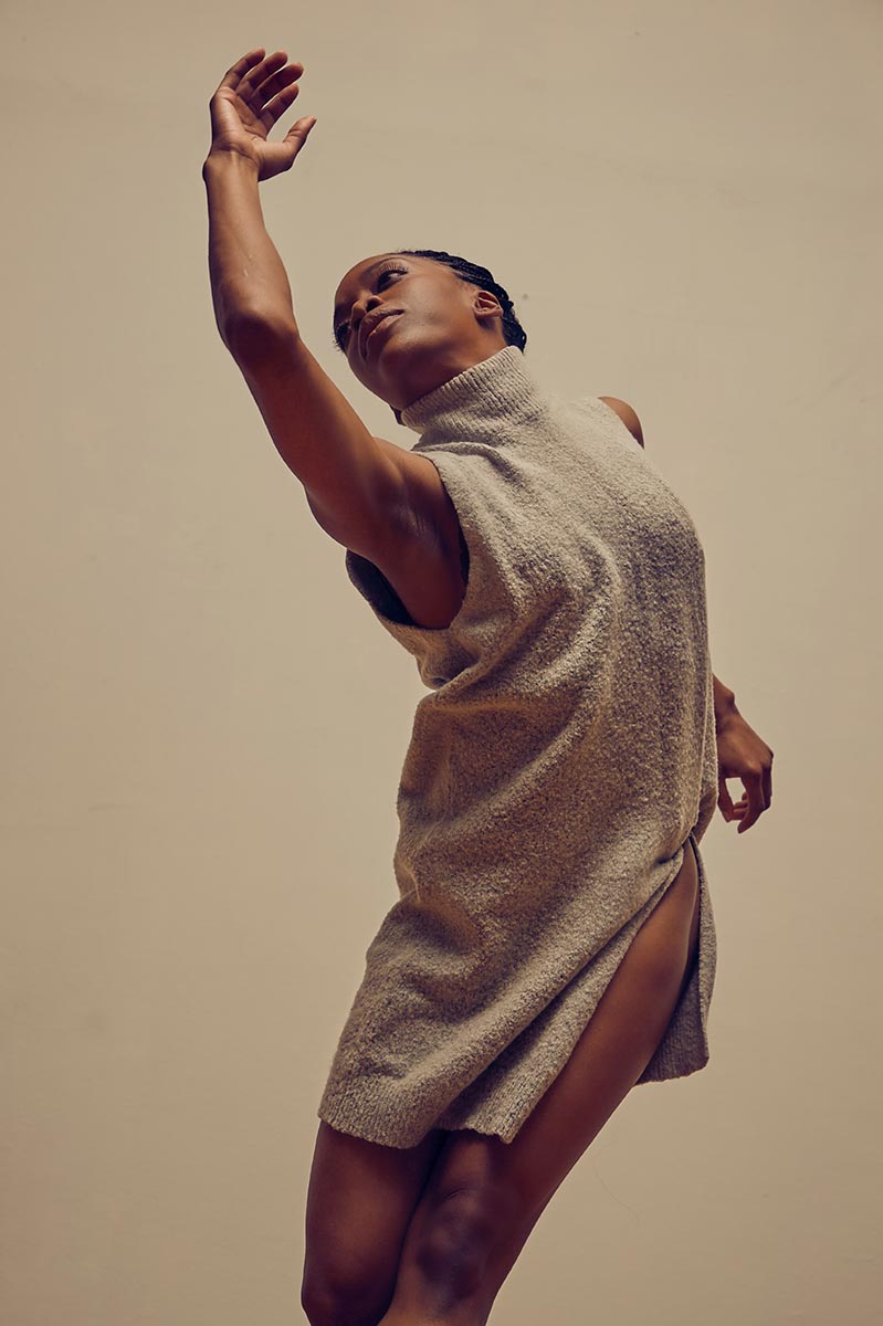 Tamisha Guy, with arm raised, in a dance.